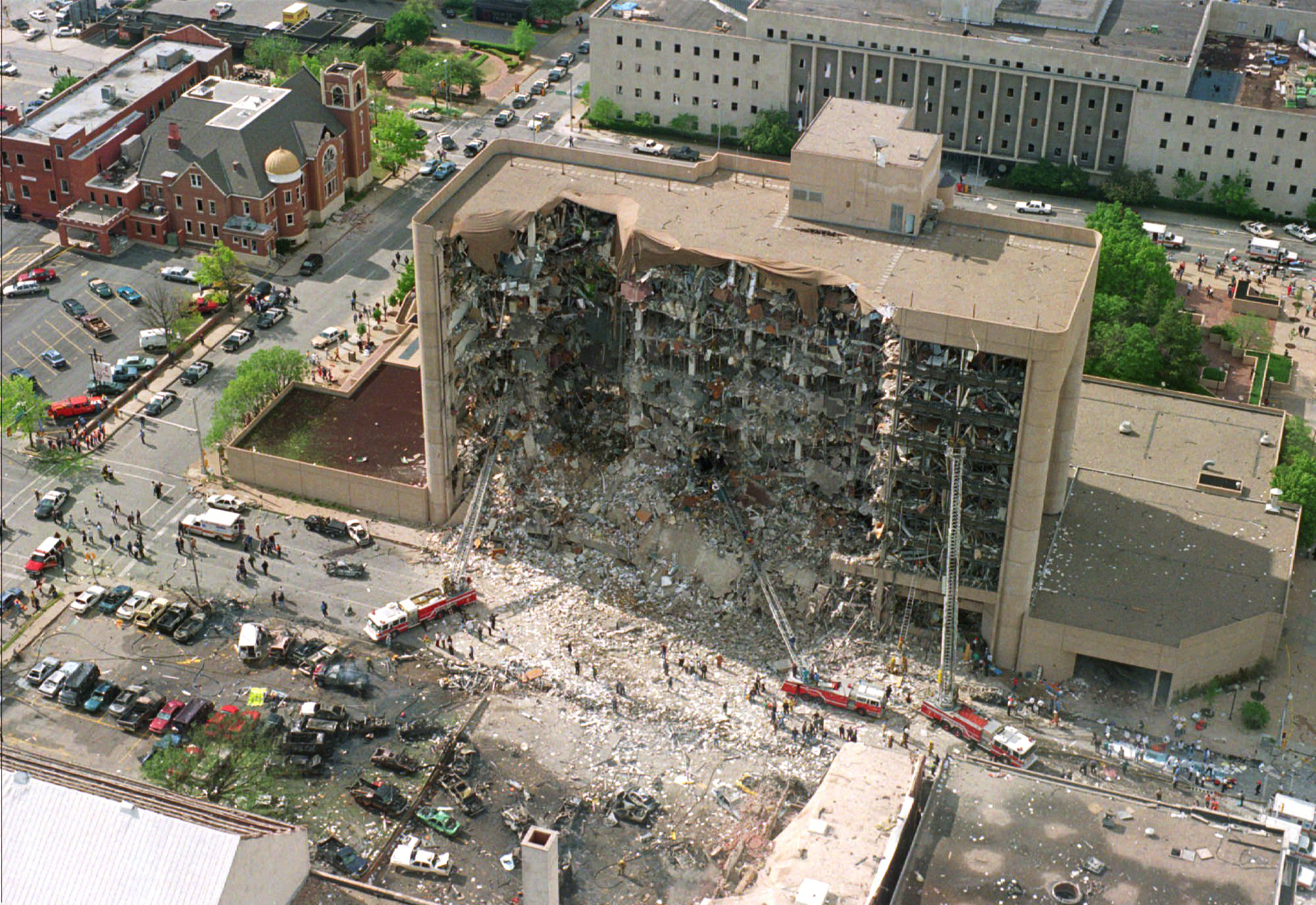 This April 19, 1995, file photo shows the north side of the Alfred Murrah Federal Building after a car bomb blast in Oklahoma City. Rescuers who responded to past disasters say the search for victims of the Florida condo collapse that occurred on June 24, 2021, brought back memories of the Oklahoma City bombing and the Sept. 11 attacks. (AP Photo, File)