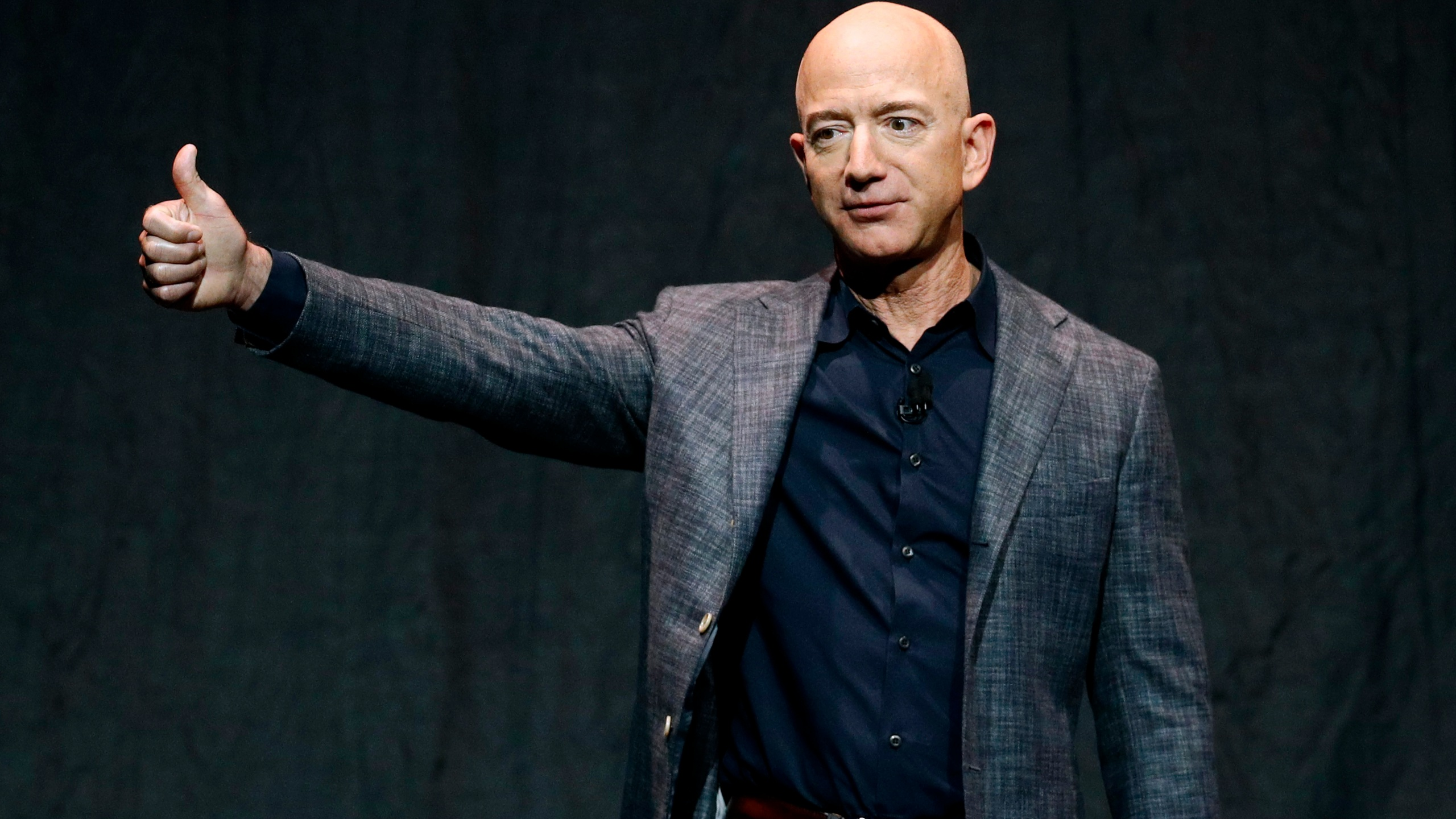 In this Thursday, May 9, 2019, file photo, Jeff Bezos speaks at an event before unveiling Blue Origin's Blue Moon lunar lander, in Washington. On Monday, July 12, 2021, the Federal Aviation Administration approved Blue Origin's attempt to launch people into space. (AP Photo/Patrick Semansky, File)