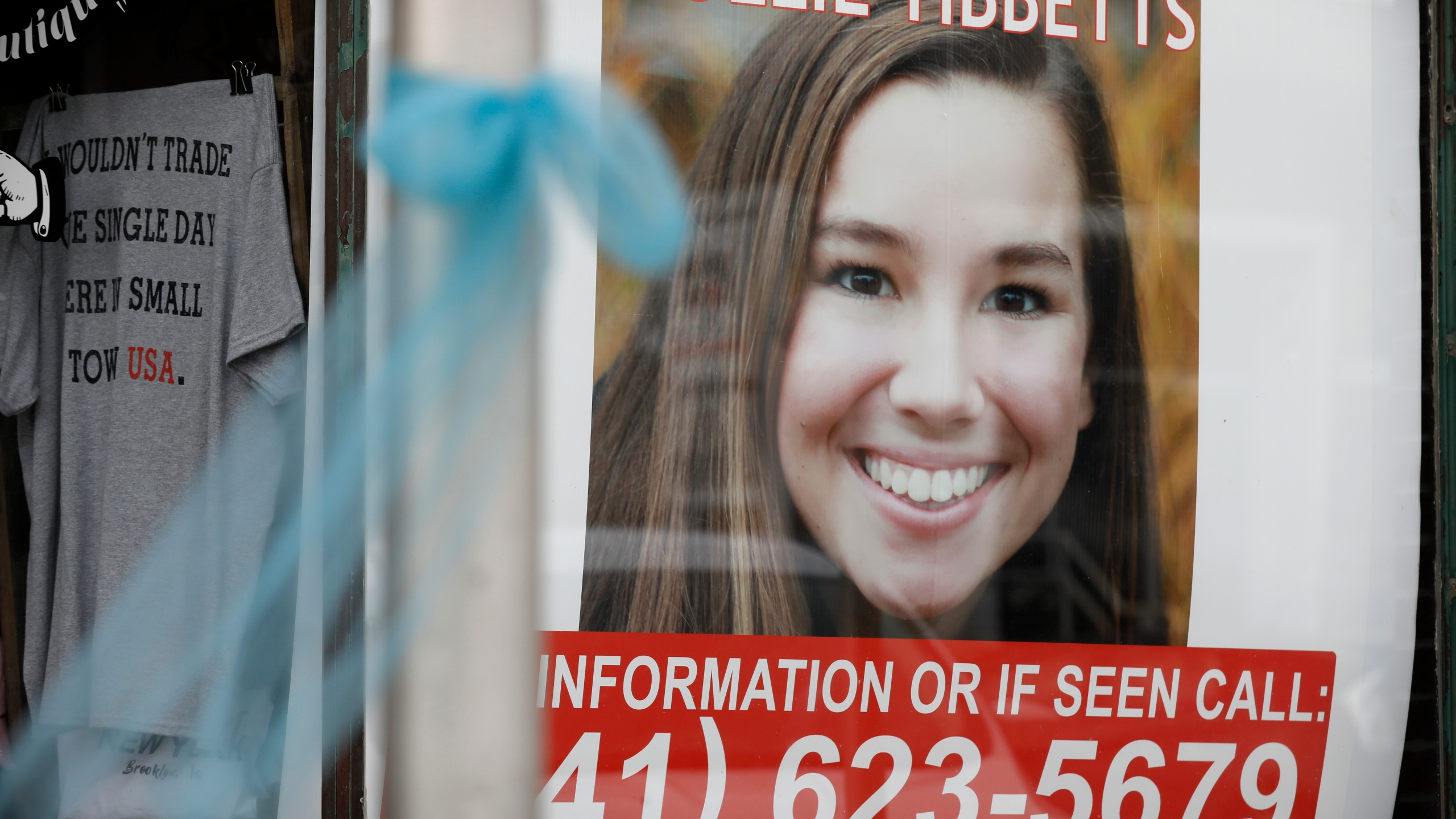 A poster for missing University of Iowa student Mollie Tibbetts hangs in the window of a local business in Brooklyn, Iowa, on Aug. 21, 2018. (Charlie Neibergall / Associated Press)