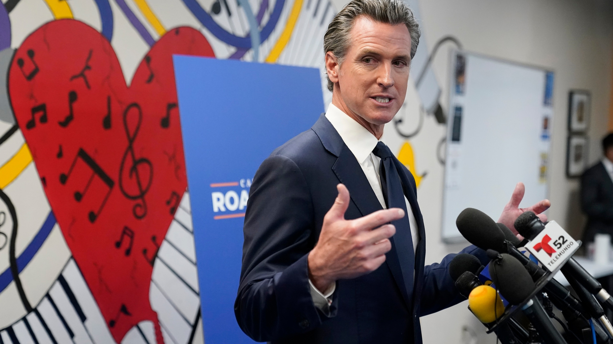 California Gov. Gavin Newsom fields questions after a rally where he signed the California Comeback Plan relief bill Tuesday, July 13, 2021, in Los Angeles. (AP Photo/Marcio Jose Sanchez)