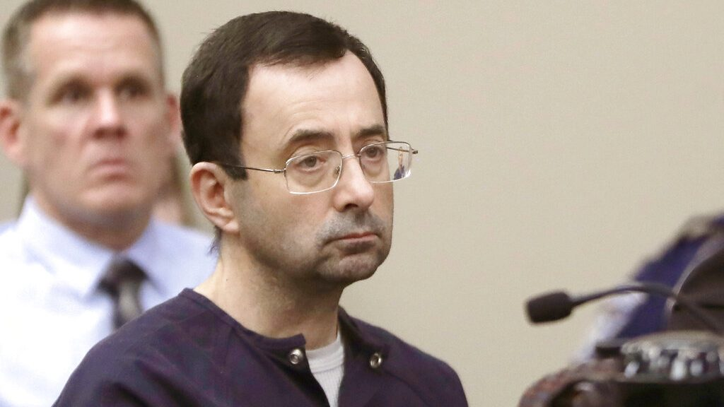 Larry Nassar, a former doctor for USA Gymnastics and member of Michigan State's sports medicine staff, sits in court during his sentencing hearing in Lansing, Mich., on Jan. 24, 2018. (Carlos Osorio / Associated Press)