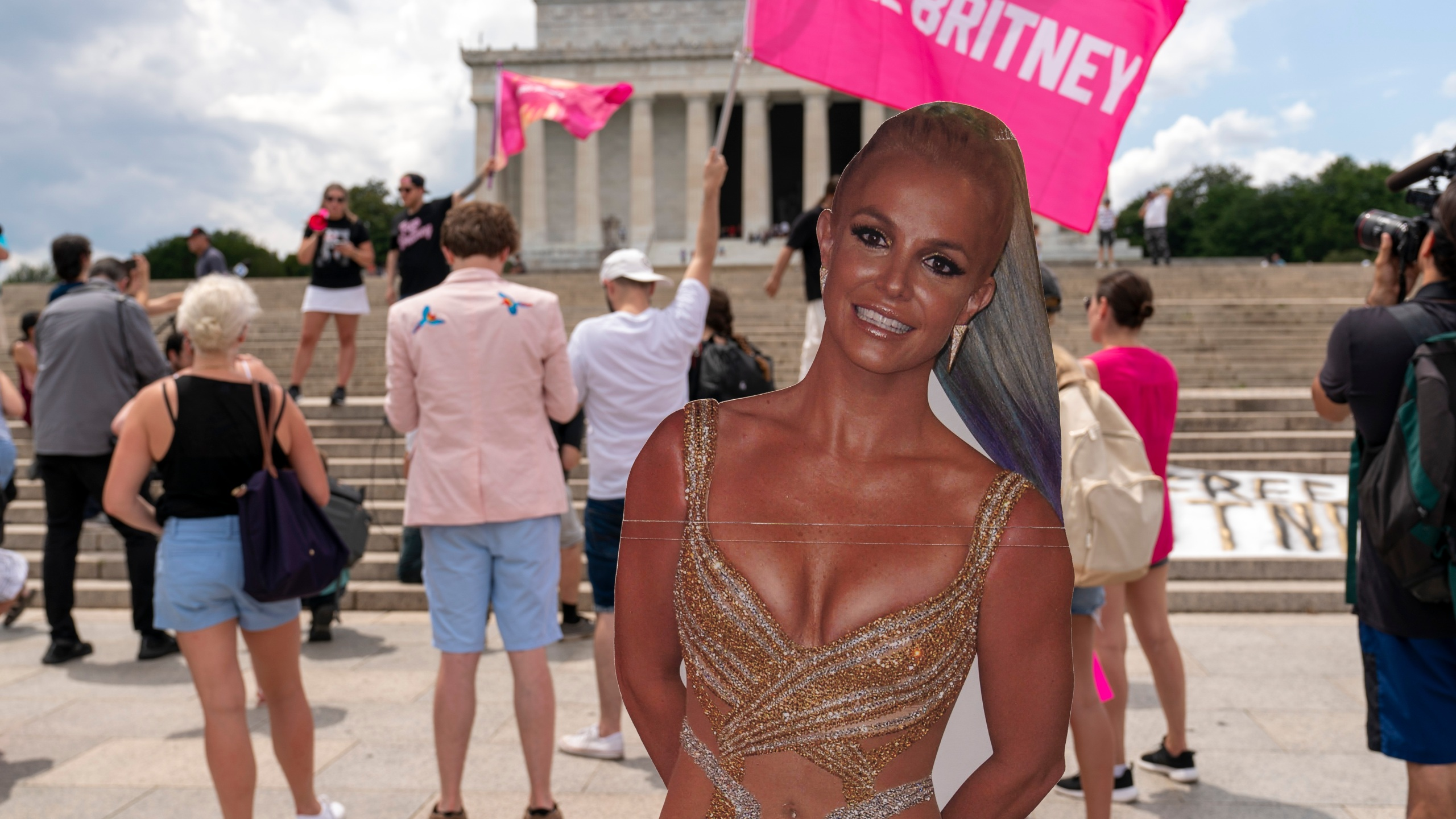 """Fans and supporters of pop star Britney Spears protest at the Lincoln Memorial, during the """"Free Britney"""" rally, Wednesday, July 14, 2021, in Washington. Rallies have been taking place across the country since the pop star spoke out against her conservatorship in court last month. (AP Photo/Jose Luis Magana)"""