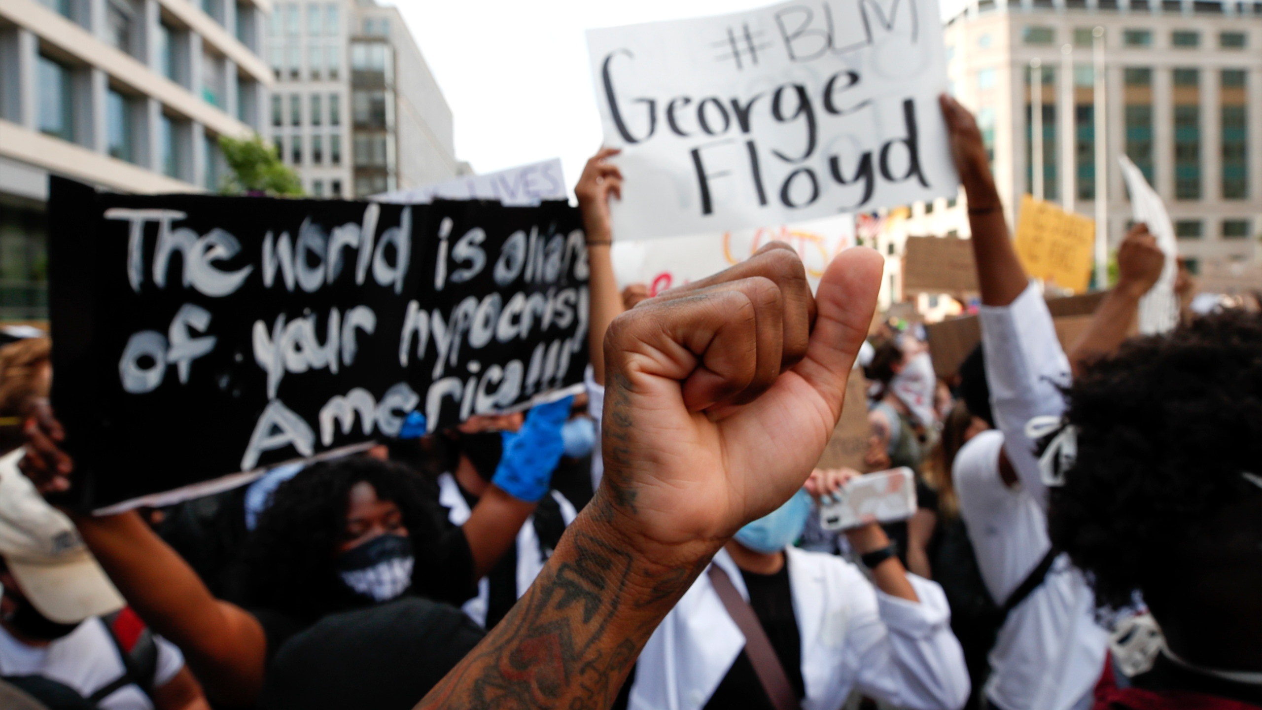 In this June 3, 2020, file photo, demonstrators gather near the White House in Washington to protest the death of George Floyd. A report released Thursday, July 15, 2021, says more than 90% of donors who supported racial equity initiatives in 2018 have yet to report how much they gave in 2020. (AP Photo/Alex Brandon, File)