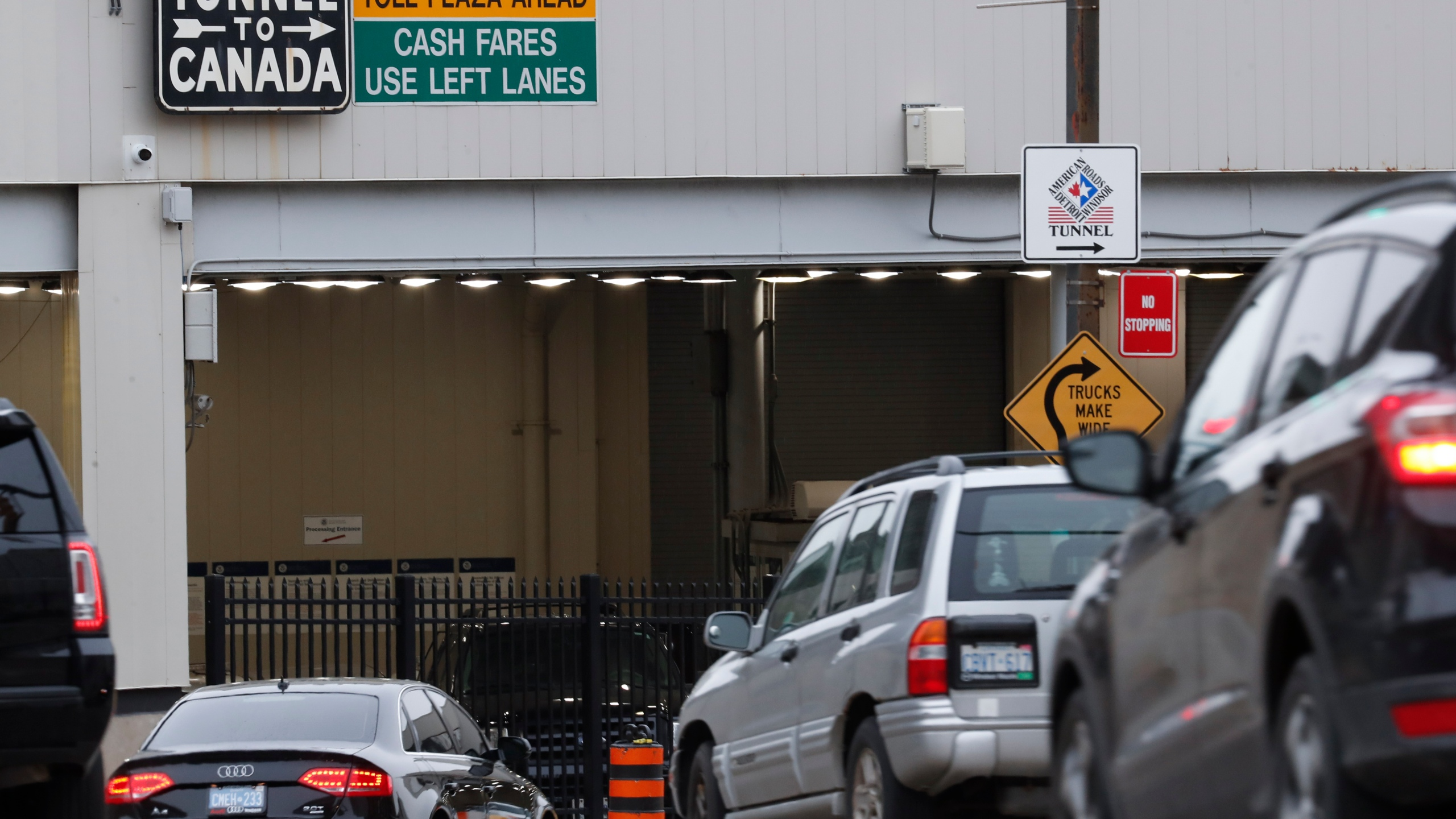 In this March 16, 2020, file photo, vehicles enter the Detroit-Windsor Tunnel in Detroit to travel to Canada. (Paul Sancya/Associated Press)
