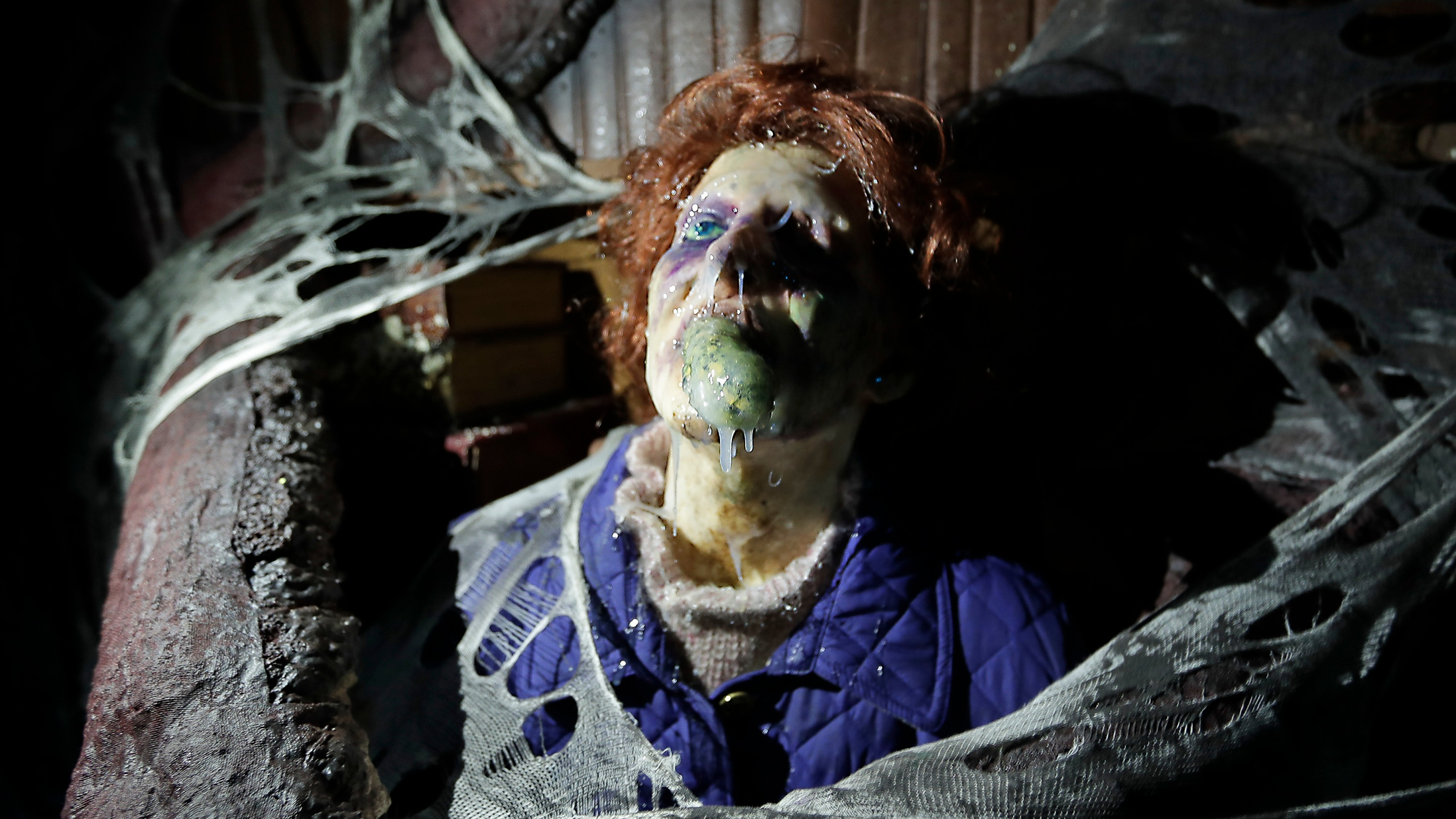 """In this Sept. 12, 2018 file photo, the character Barb appears in grand, gory style in the Stranger Things haunted house during Halloween Horror nights at Universal Studios in Orlando, Fla. After a pandemic-related absence of a year, Halloween Horror Nights are back with haunted houses based on the """"Texas Chainsaw Massacre"""" and """"The Bride of Frankenstein"""" planned for Universal theme parks in California and Florida, the company announced Thursday, July 15, 2021. (AP Photo/John Raoux, File)"""