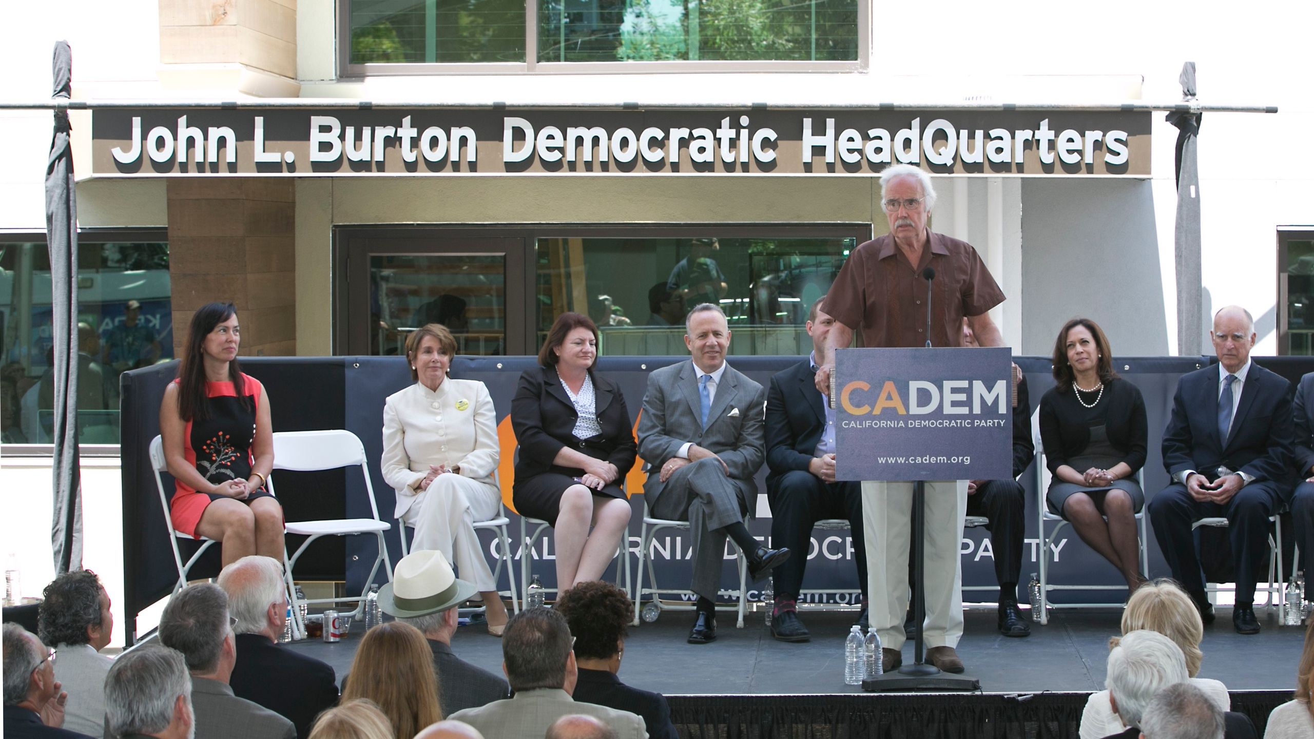 In this June 16, 2014, file photo. then-California Democratic Party Chairman John Burton speaks during the dedication of the John L. Burton California Democratic Party Headquarters in Sacramento, Calif., in Sacramento, Calif. Two California men have been charged with plotting to blow up the state Democratic Party's headquarters in Sacramento, a bombing they hoped would be the first in a series of politically-motivated attacks, federal prosecutors said Thursday, July 15, 2021. From left are then-House Minority Leader Nancy Pelosi, then-Assembly Speaker Toni Atkins, then-state Senate President Pro Term Darrell Steinberg. At right is then-Gov. Jerry Brown and second from right is then-California Attorney General Kamala Harris. (AP Photo/Rich Pedroncelli, File)