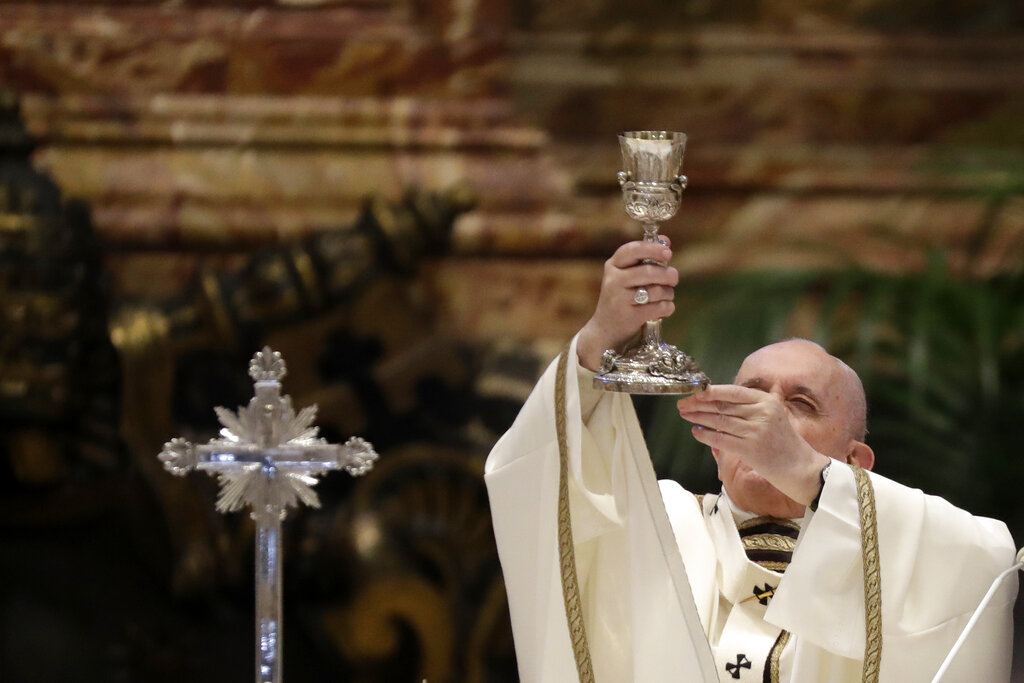In this Thursday, April 1, 2021 file photo, Pope Francis celebrates a Chrism Mass inside St. Peter's Basilica, at the Vatican. (AP Photo/Andrew Medichini)