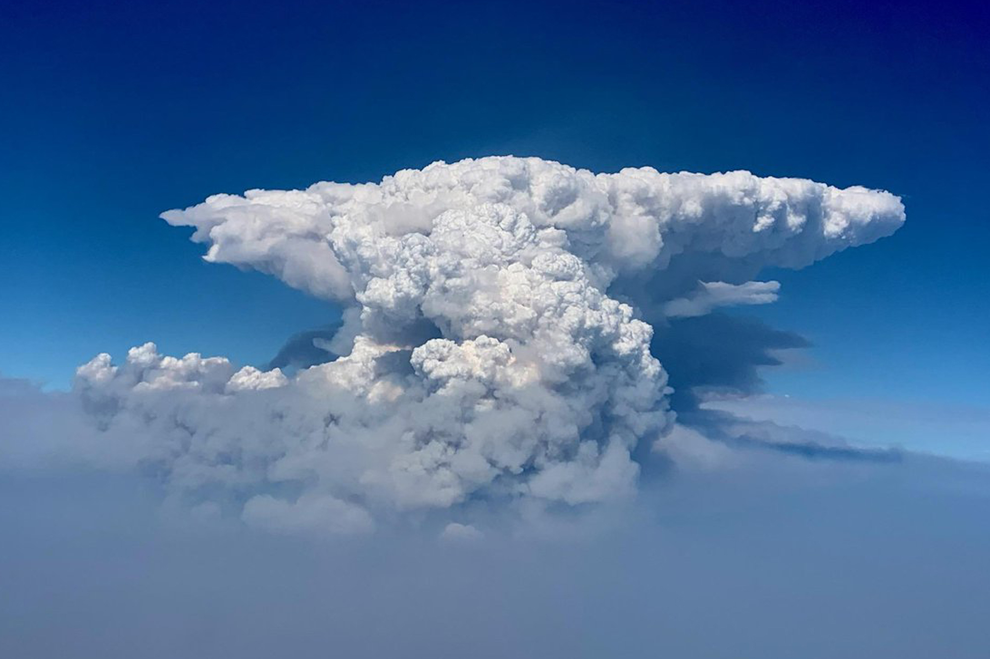 In this photo taken with a drone provided by the Bootleg Fire Incident Command, a pyrocumulus cloud, also known as a fire cloud, is seen over the Bootleg Fire in southern Oregon on July 14, 2021. (Bootleg Fire Incident Command via AP)
