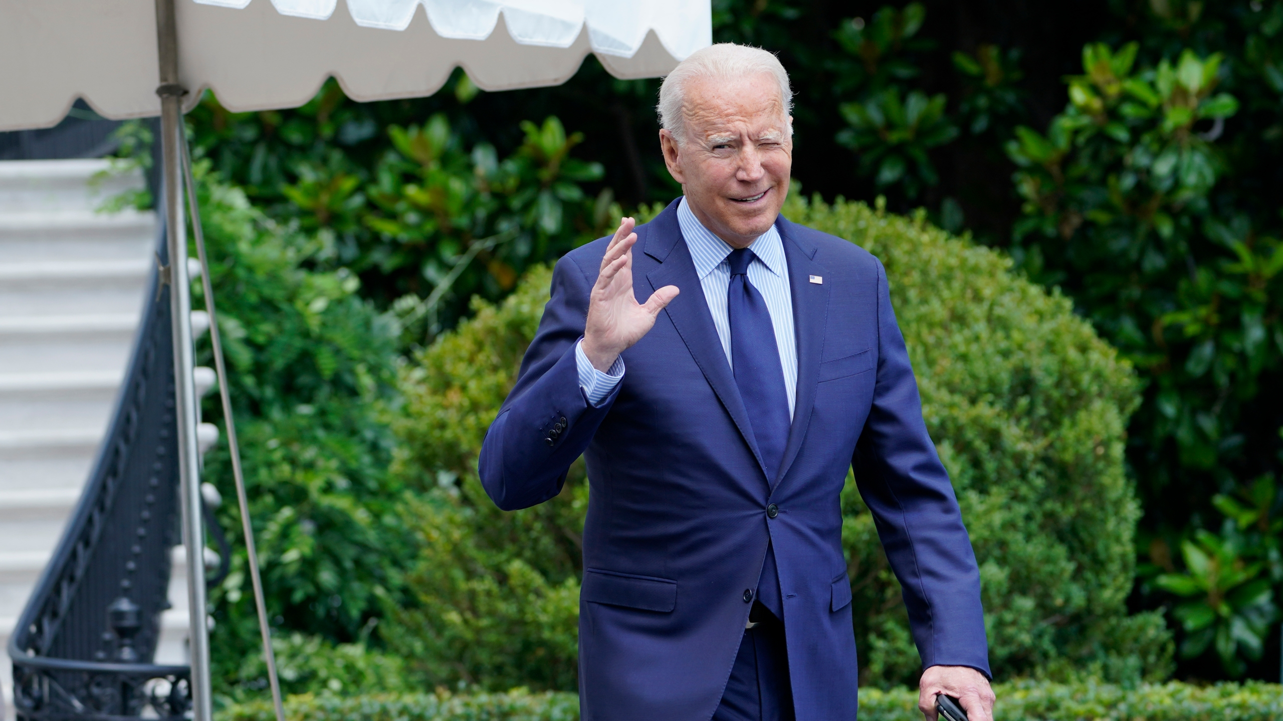 President Joe Biden tries to hear questions shouted by reporters as he heads to Marine One on the South Lawn of the White House in Washington, Friday, July 16, 2021, to spend the weekend at Camp David. (AP Photo/Susan Walsh)