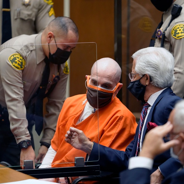 """Michael Thomas Gargiulo, left, listens to his defense attorneys, Daniel Nardoni, middle, and Dale Michael Rubin during a sentencing hearing at Los Angeles Superior Court, Friday, July 16, 2021. A judge denied a new trial for Garigiulo, a man prosecutors called """"The Boy Next Door Killer,"""" who could be sentenced to death later Friday for the home-invasion murders of two women and the attempted murder of a third. (AP Photo/Damian Dovarganes)"""