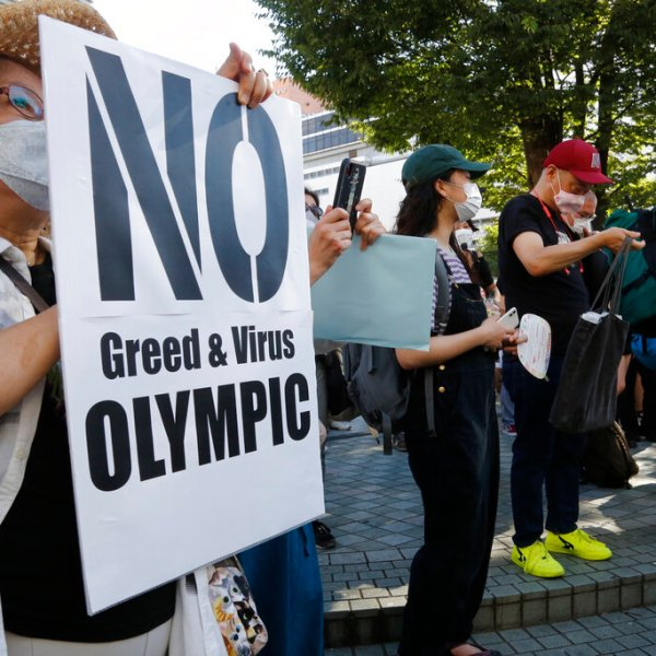 People gather for a rally in Tokyo's Shinjuku shopping district Sunday, July 18, 2021, to protest against the Olympics starting from July 23. (AP Photo/Yuri Kageyama)