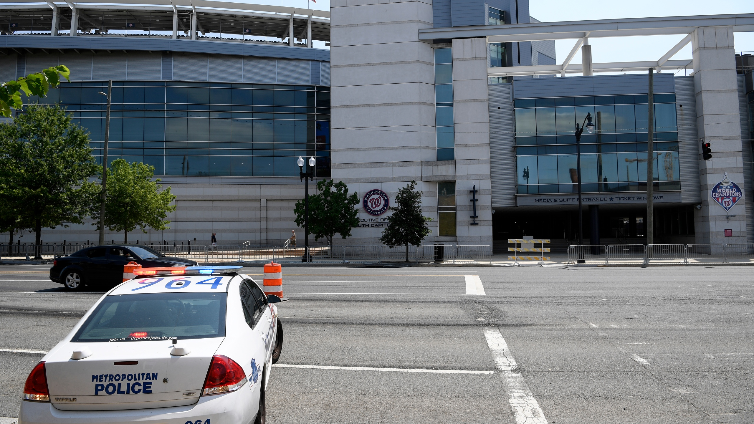 A police car is seen across from Nationals Park, Sunday, July 18, 2021, in Washington. (AP Photo/Nick Wass)