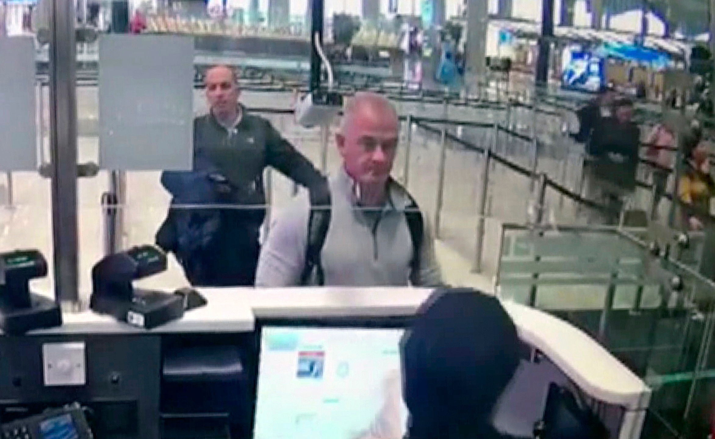 This Dec. 30, 2019, image from security camera video shows Michael L. Taylor, center, and George-Antoine Zayek at passport control at Istanbul Airport in Turkey. A Tokyo court handed down prison terms for the American father Michael Taylor and son Peter accused of helping Nissan's former chairman, Carlos Ghosn, escape to Lebanon while awaiting trial in Japan.(DHA via AP, File)