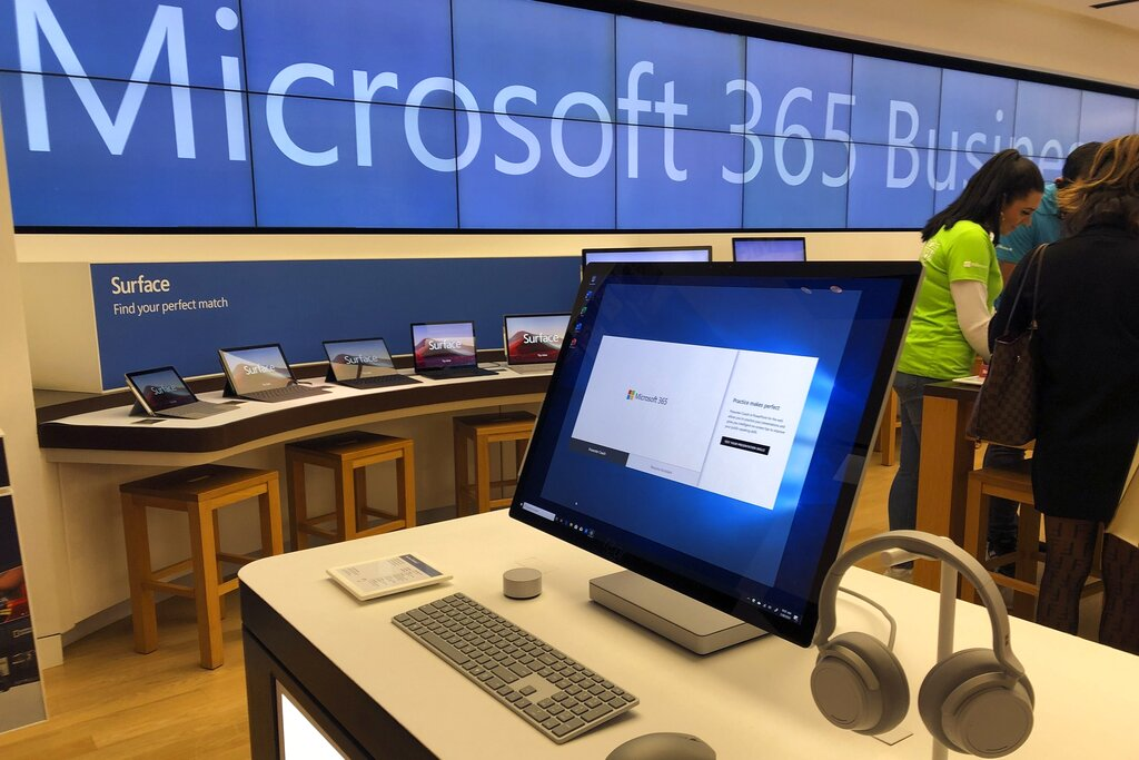 In this Jan. 28, 2020, file photo, a Microsoft computer is among items displayed at a Microsoft store in suburban Boston. (AP Photo/Steven Senne)