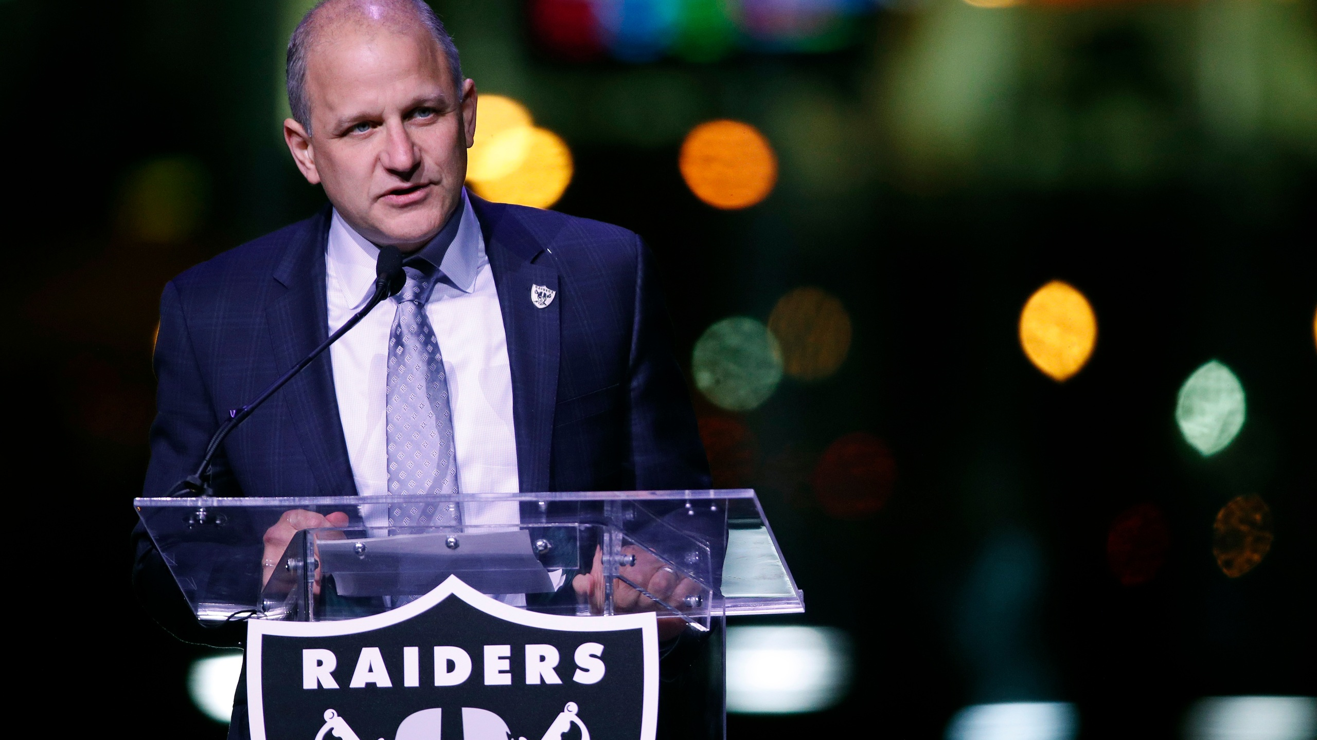 In this Nov. 13, 2017, file photo, Oakland Raiders President Marc Badain speaks during a ceremonial groundbreaking for the Raiders' stadium in Las Vegas. (AP Photo/John Locher, File)