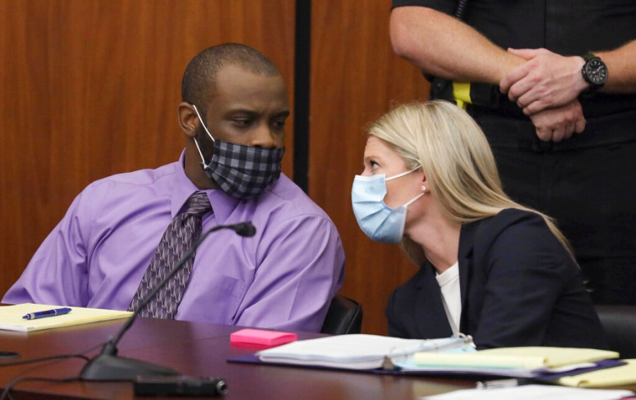 Defendant Nathaniel Rowland speaks with his attorney, Alicia Goode, right, during his trial in Richland County Court, Tuesday, July 20, 2021, in Columbia, S.C. (Tracy Glantz/The State via AP)
