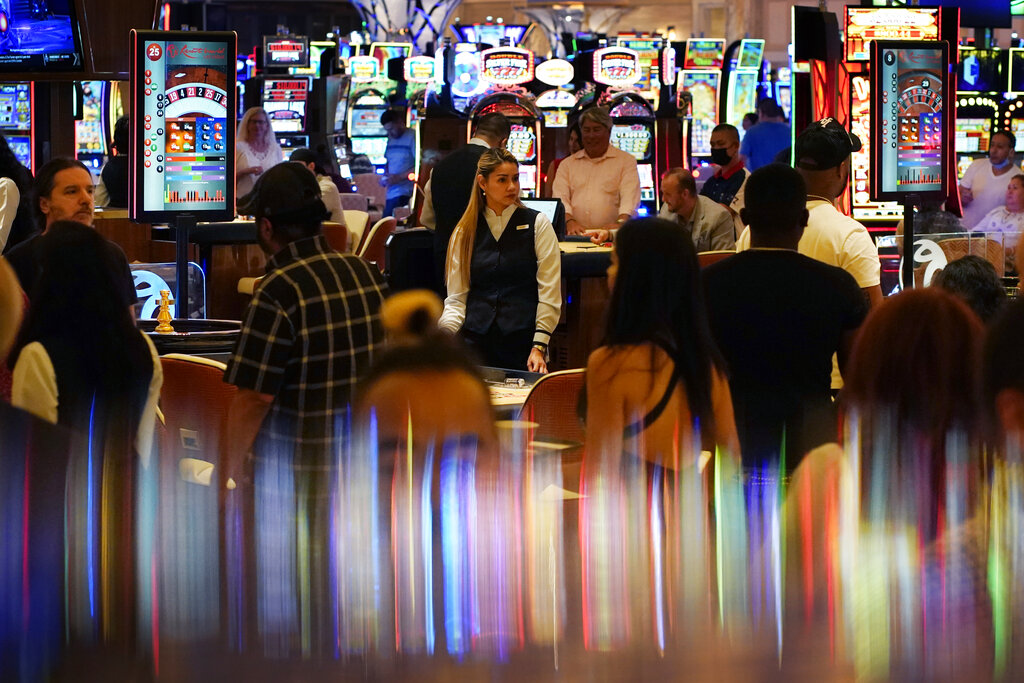 In this June 24, 2021, file photo, crowds walk through the casino during the opening night of Resorts World Las Vegas in Las Vegas. (AP Photo/John Locher, File)