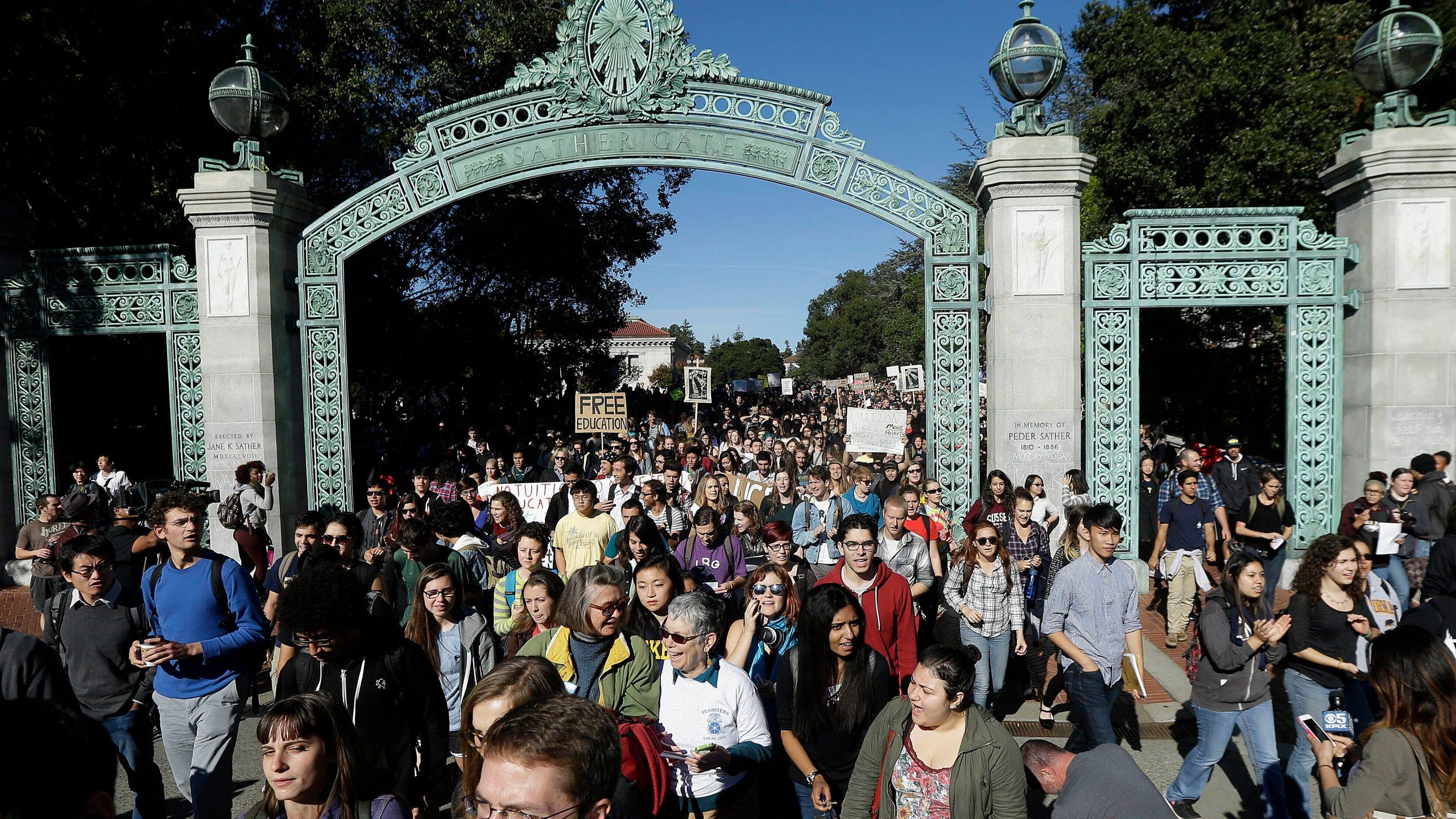 Students march under Sather Gate during a tuition-hike protest at the UC Berkeley on Nov. 24, 2014. (Jeff Chiu / Associated Press)