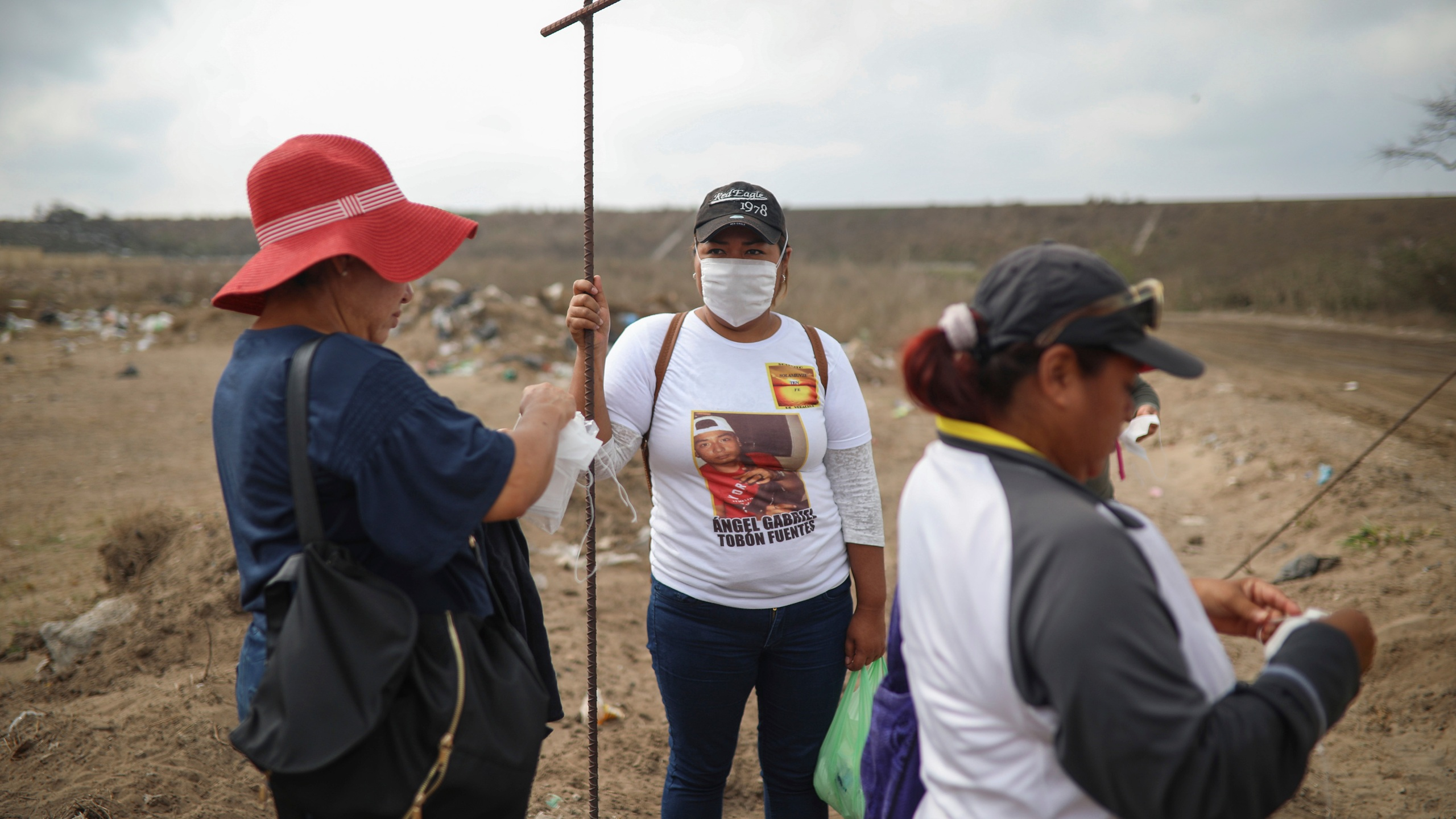 Lidia Lara Tobon, center, whose brother Angel Gabriel Tobon went missing, works with other relatives of the disappeared from the Solecito Collective, as they search for clandestine graves inside a municipal dump on March 11, 2019, after an anonymous source sent the group a map suggesting hundreds of bodies were buried in the area, in the port city of Veracruz, Mexico. (Felix Marquez / Associated Press)