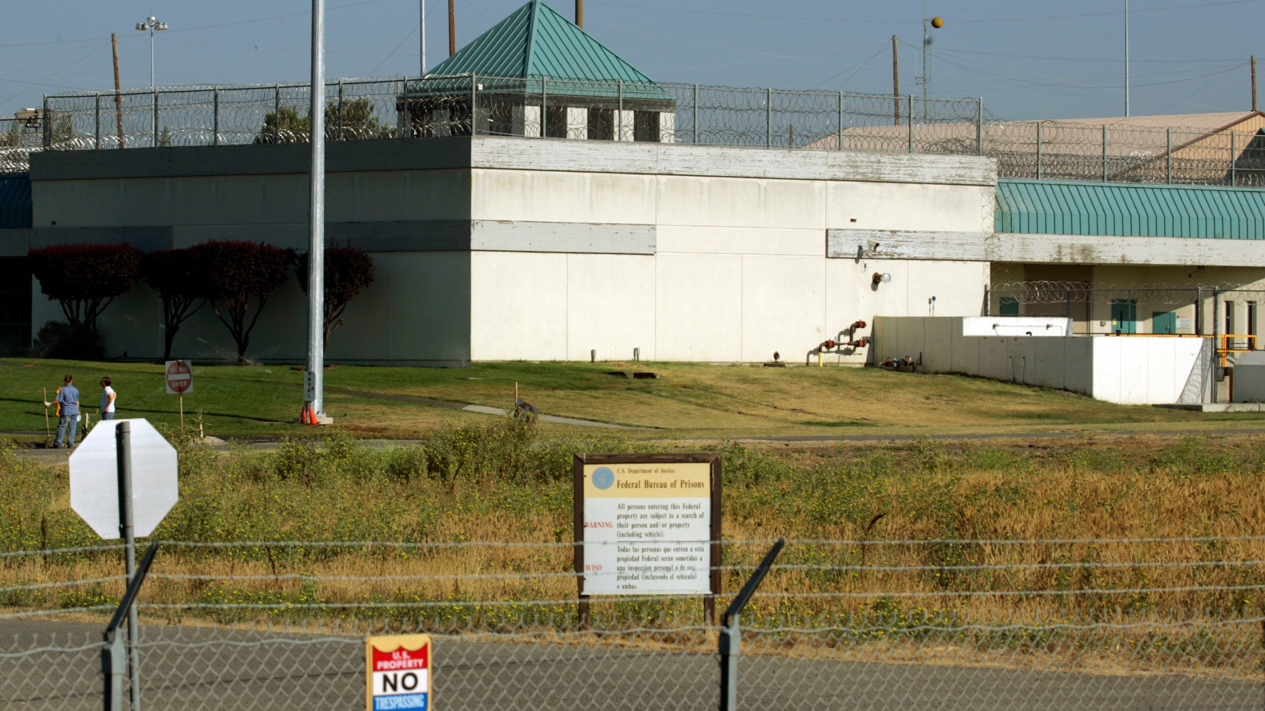 In this July 20, 2006, file photo, the Federal Correctional Institution in Dublin, Calif. Federal investigators have questioned the warden of the federal women's prison in California and searched his office. It comes weeks after a former correctional officer at the facility was arrested on charges of sexually abusing inmates. It wasn't immediately clear if the search at the Federal Correctional Institution at Dublin was connected to last month's arrest. (AP Photo/Ben Margot, File)