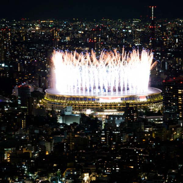 Fireworks illuminate over the National Stadium during the opening ceremony of 2020 Tokyo Olympics views from Shibuya Sky observation deck Friday, July 23, 2021, in Tokyo, Japan. (AP Photo/Eugene Hoshiko)