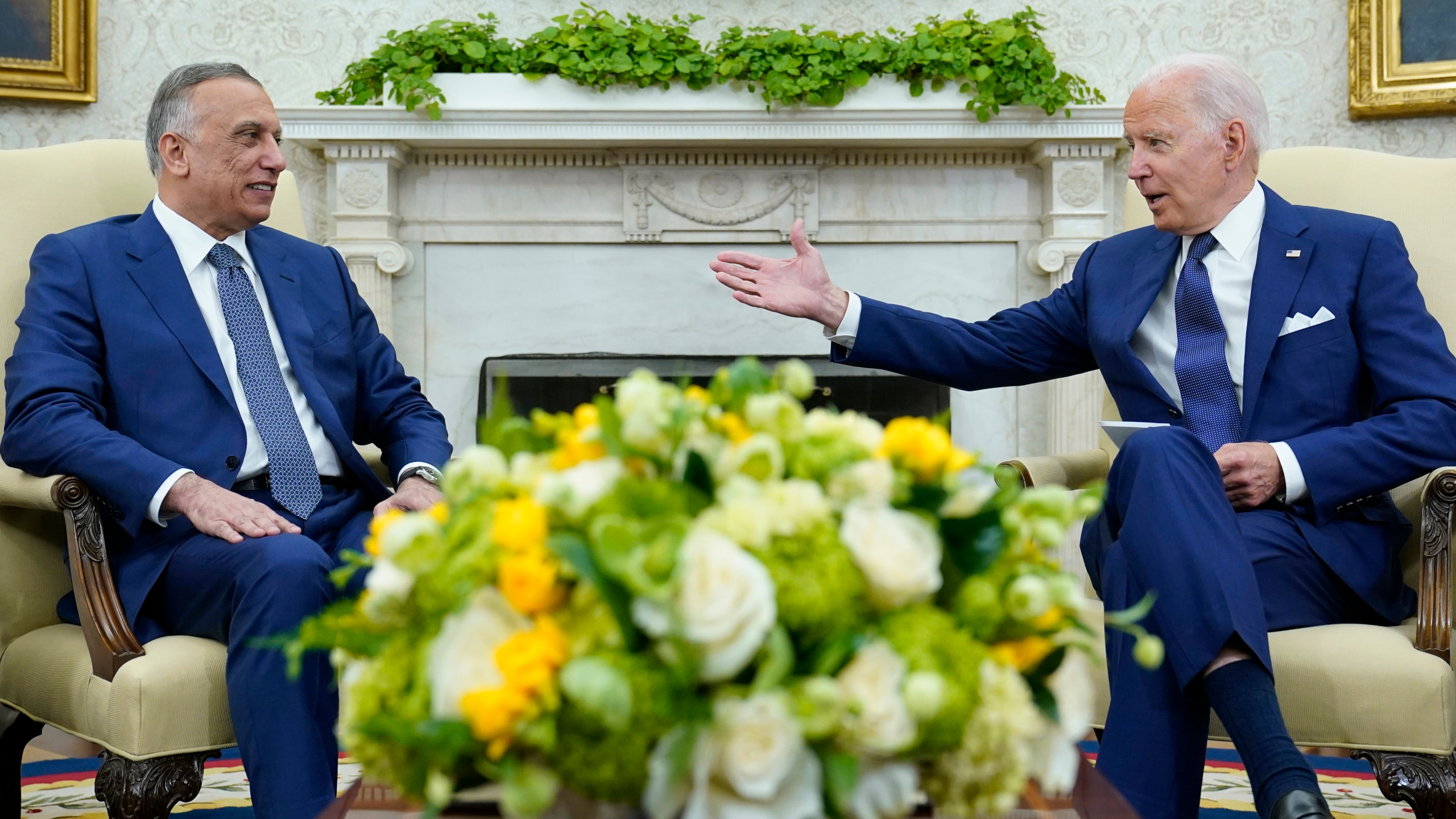 President Joe Biden, right, speaks as Iraqi Prime Minister Mustafa al-Kadhimi, left, listens during their meeting in the Oval Office of the White House in Washington on July 26, 2021. (AP Photo/Susan Walsh)