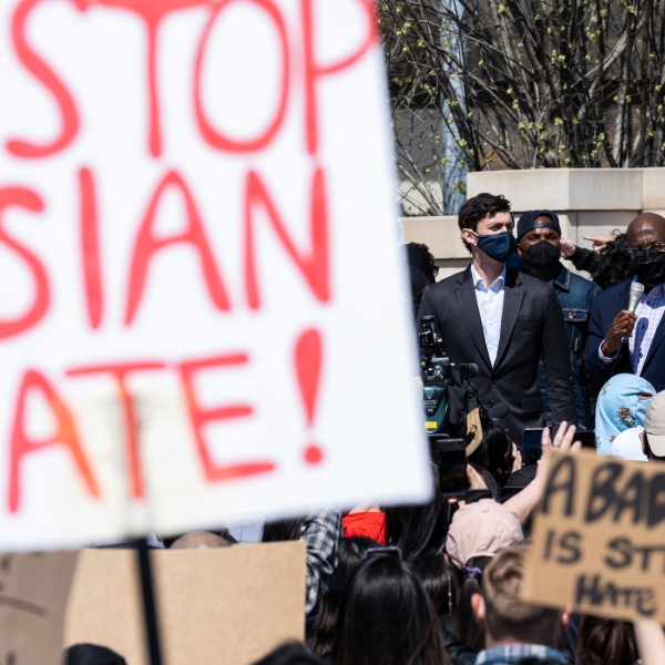 """This March 20, 2021 file photo shows U.S. Sens. Jon Ossoff, D-Ga., and Raphael Warnock, D-Ga., speaking during a """"stop Asian hate"""" rally outside the Georgia State Capitol in Atlanta. (Ben Gray/Associated Press)"""