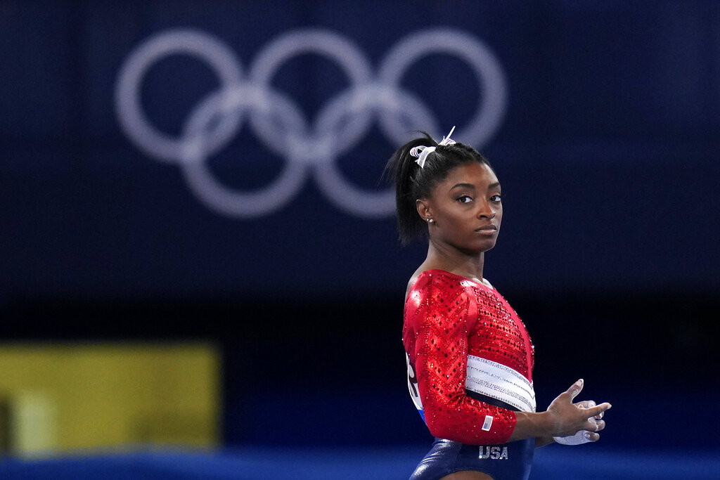 This July 27, 2021, file photo shows Simone Biles, of the United States, waiting to perform on the vault during the artistic gymnastics women's final at the 2020 Summer Olympics, Tuesday, July 27, 2021, in Tokyo. (AP Photo/Gregory Bull, File)