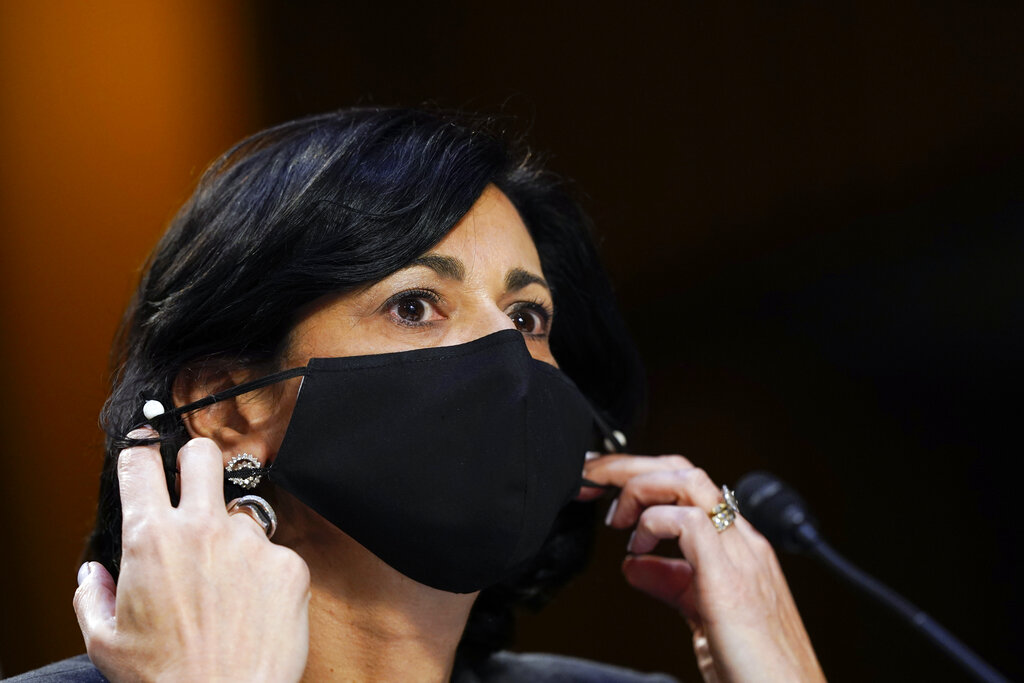 Dr. Rochelle Walensky, director of the Centers for Disease Control and Prevention, adjusts her face mask during a Senate Health, Education, Labor and Pensions Committee hearing on the federal coronavirus response on Capitol Hill in Washington, in this Thursday, March 18, 2021, file photo. (AP Photo/Susan Walsh, Pool, File)