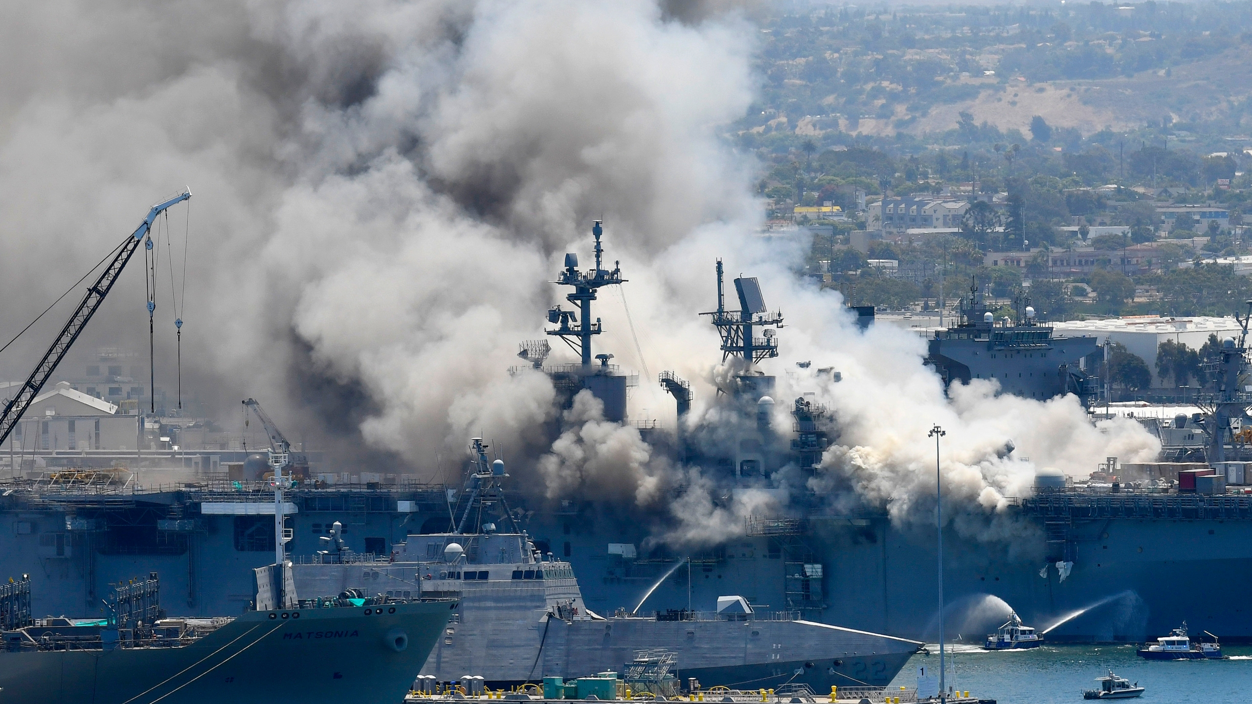 In this July 12, 2020, file photo, smoke rises from the USS Bonhomme Richard in San Diego after an explosion and fire on board the ship at Naval Base San Diego. (Denis Poroy/Associated Press)