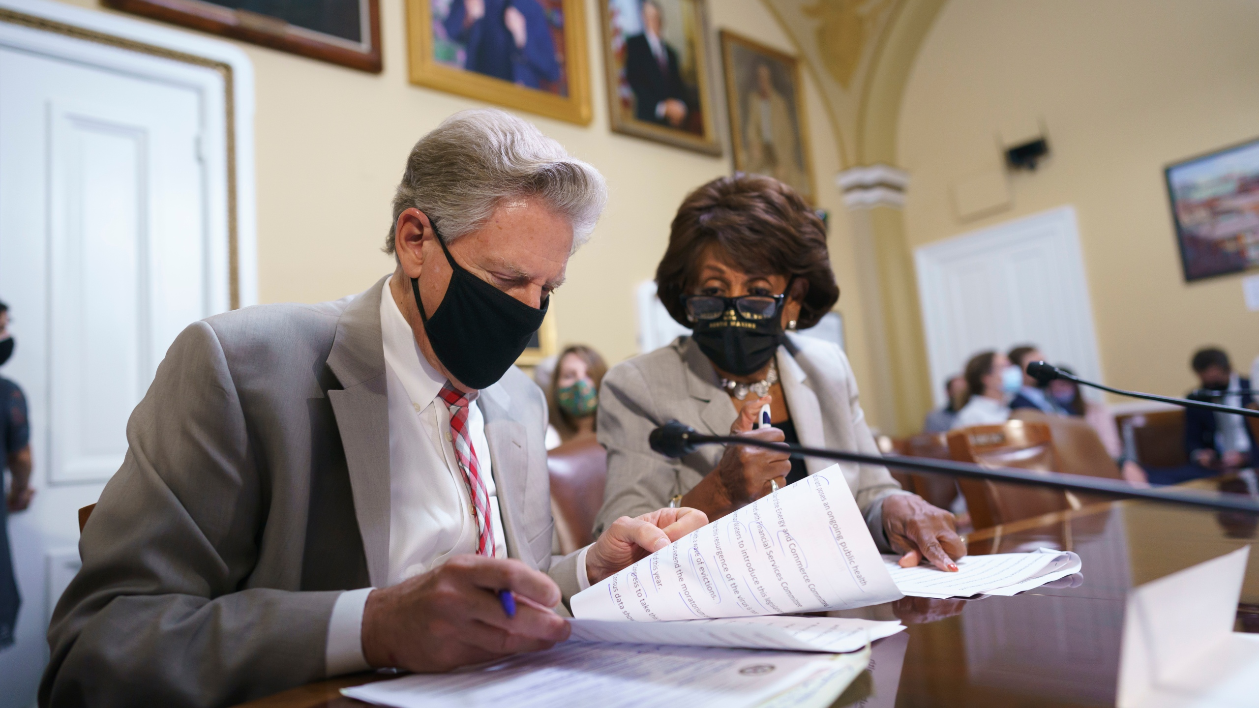 """House Energy and Commerce Chairman Frank Pallone, D-N.J., left, and House Financial Services Committee Chairwoman Maxine Waters, D-Calif., go over their notes at the House Rules Committee as they prepare an emergency extension of the eviction moratorium, at the Capitol in Washington, Friday, July 30, 2021. President Joe Biden called on """"Congress to extend the eviction moratorium to protect such vulnerable renters and their families without delay."""" (AP Photo/J. Scott Applewhite)"""