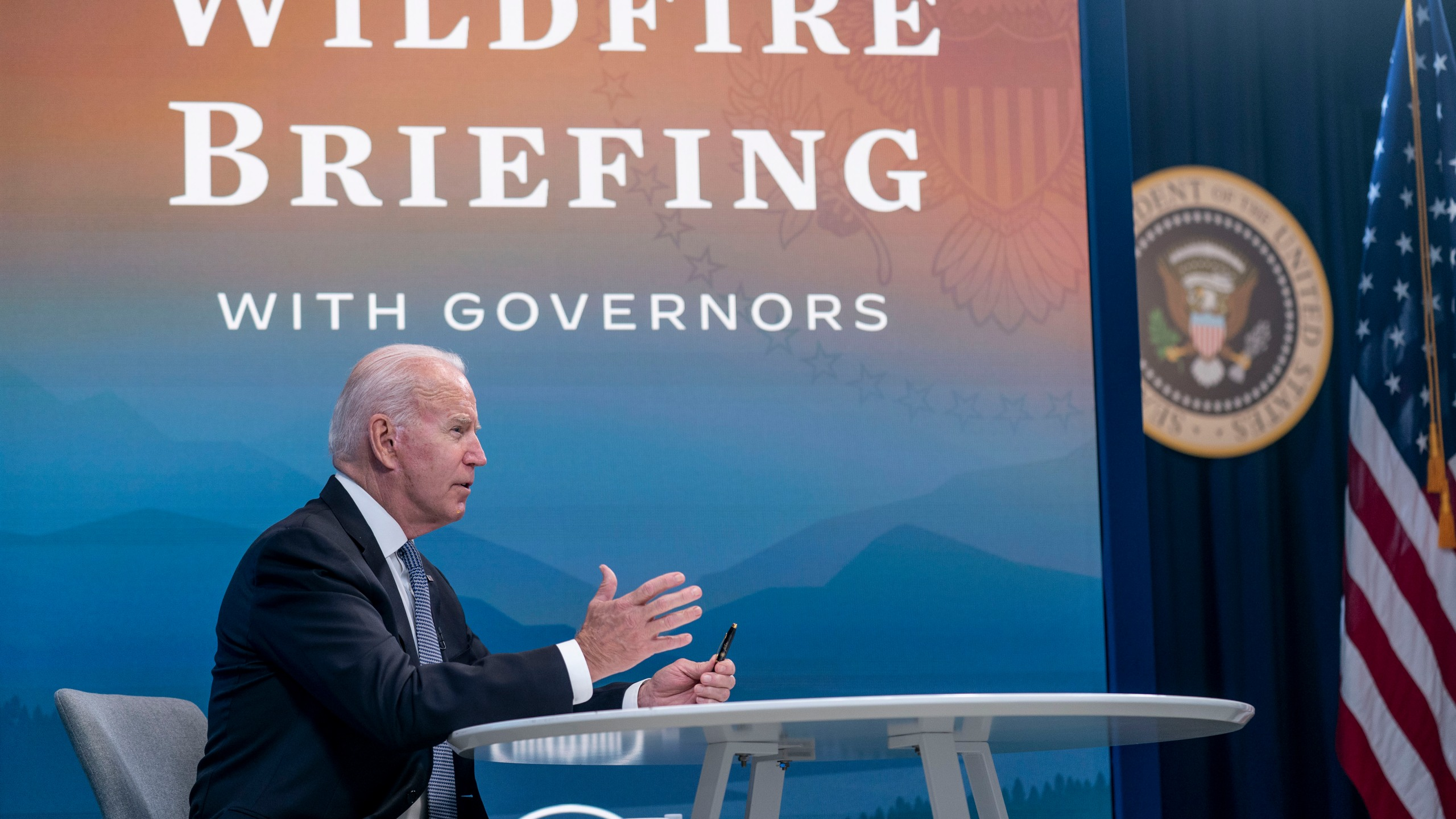 President Joe Biden speaks during a meeting with governors to discuss ongoing efforts to strengthen wildfire prevention, preparedness and response efforts, and hear firsthand about the ongoing impacts of the 2021 wildfire season in the South Court Auditorium in the Eisenhower Executive Office Building on the White House Campus in Washington, Friday, July 30, 2021. (AP Photo/Andrew Harnik)