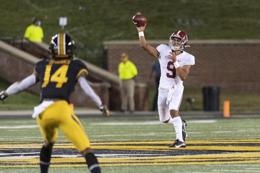 Alabama quarterback Bryce Young, shown on Sept. 26, 2020, is cashing in as young athletes are allowed to profit from their name, image and likeness. (L.G. Patterson / Associated Press)