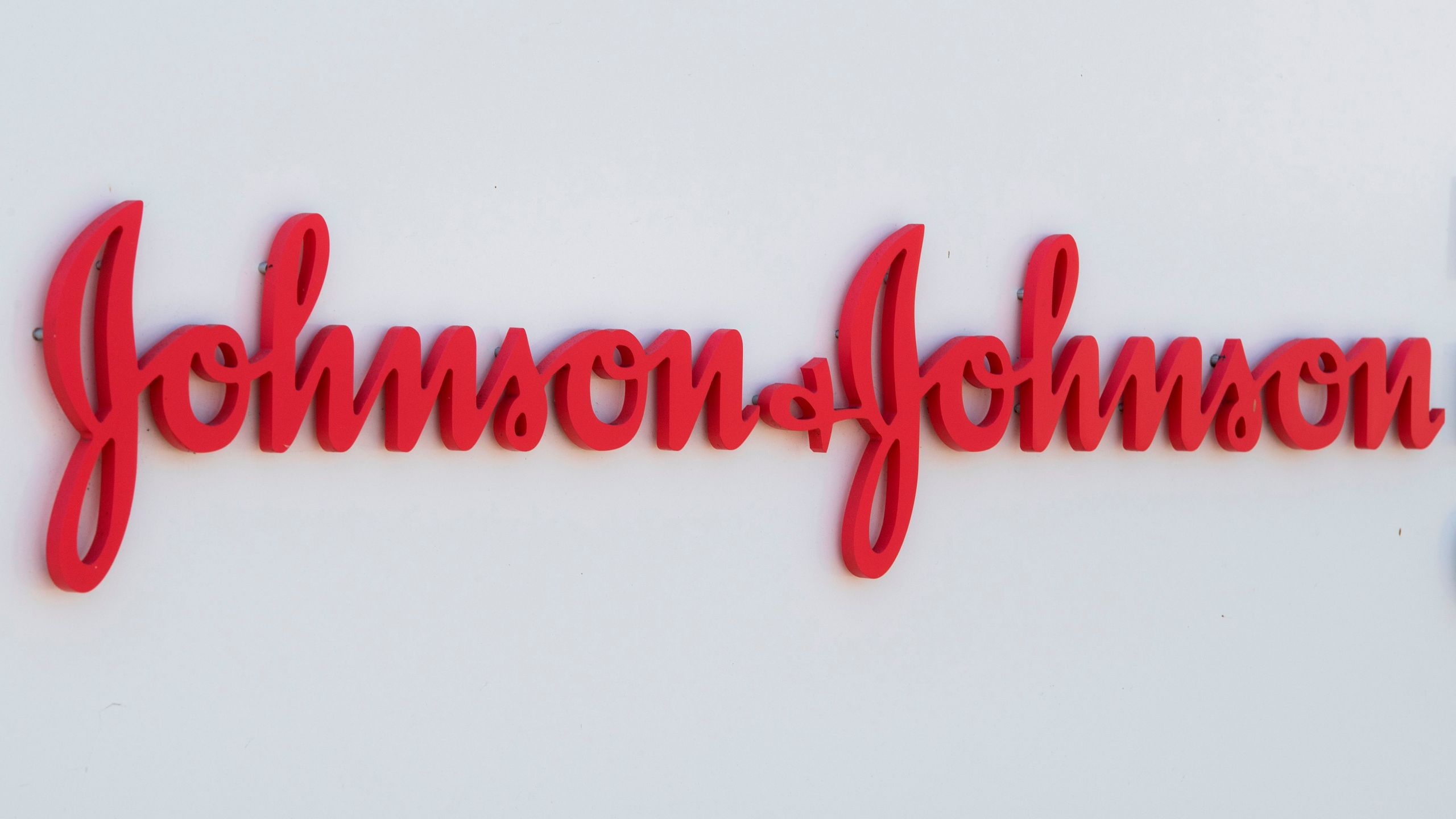 An entry sign to the Johnson & Johnson campus shows their logo in Irvine on Aug. 28, 2019. (Mark Ralston / AFP / Getty Images)