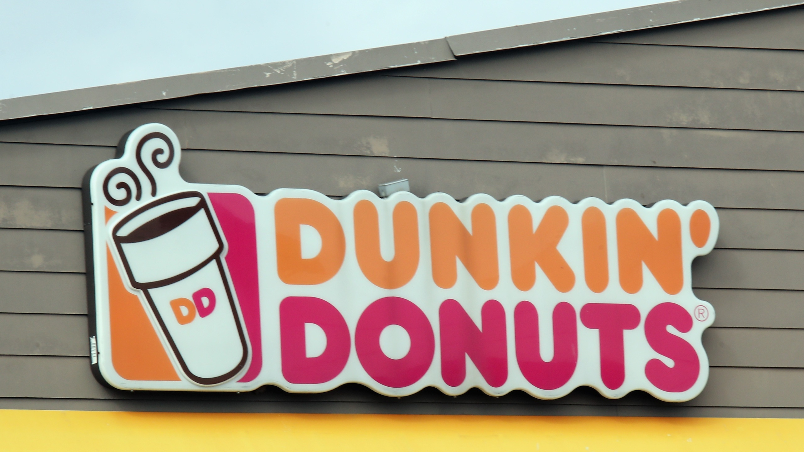 This file photo shows a Dunkin' Donuts store sign. (Bruce Bennett/Getty Images)