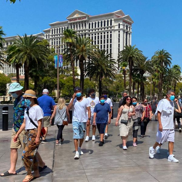 Tourists wear masks as they walk on the Strip in Las Vegas, Nevada, on Aug. 28, 2020. (DANIEL SLIM/AFP via Getty Images)