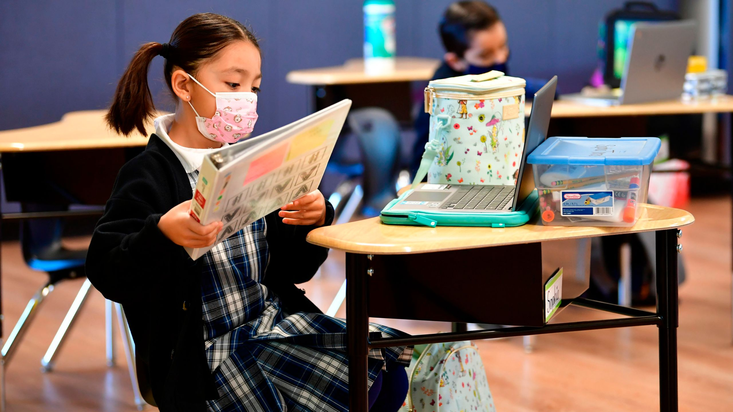 First grade students prepare for class at St. Joseph Catholic School in La Puente, California on Nov. 16, 2020 (FREDERIC J. BROWN/AFP via Getty Images)