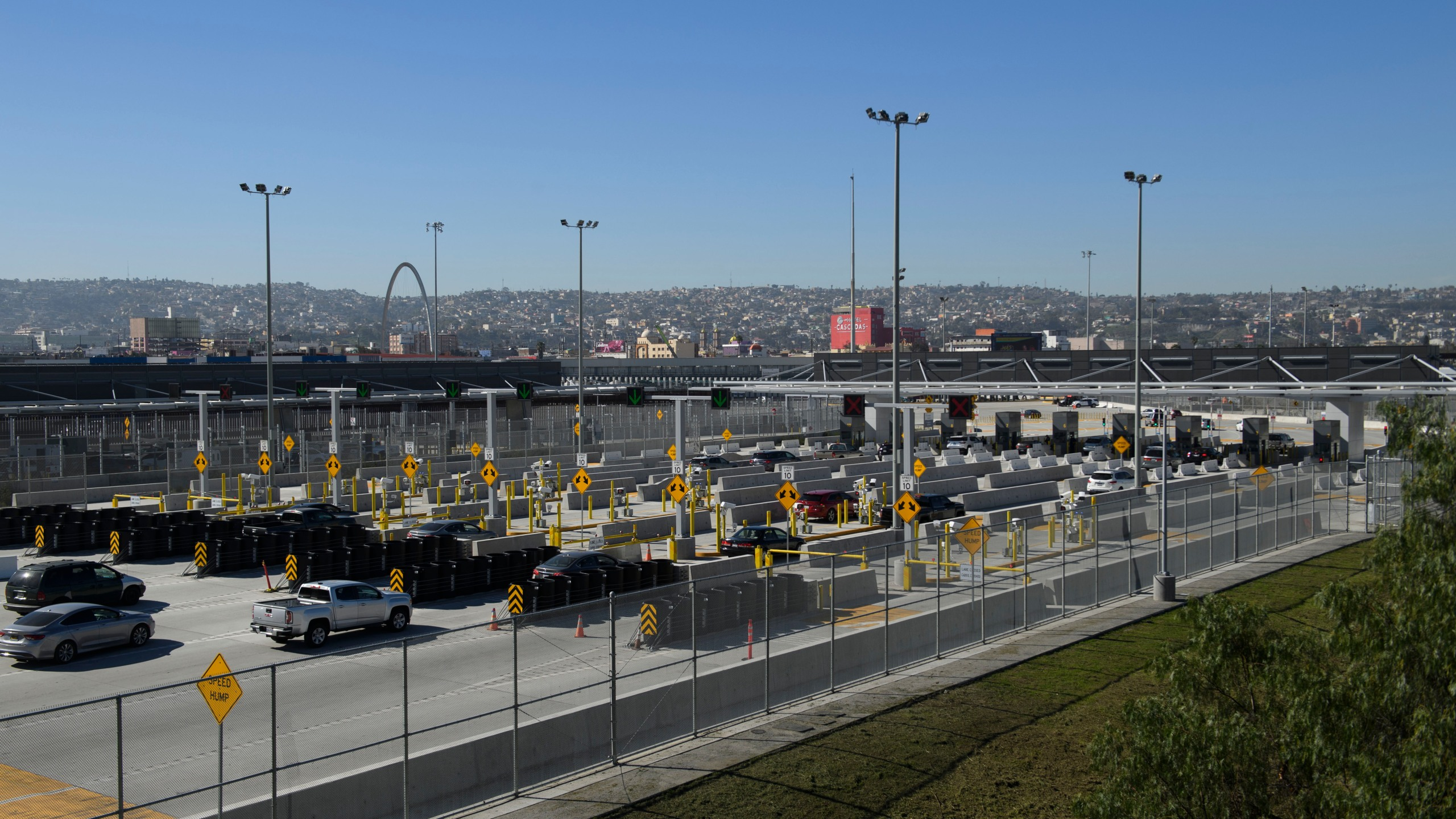 Vehicles enter a border checkpoint at the San Ysidro Port of Entry at the U.S.- Mexico border on Feb. 19, 2021 in San Diego. (PATRICK T. FALLON/AFP via Getty Images)