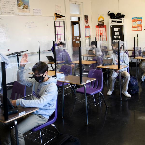 Students attend an in-person English class at St. Anthony Catholic High School on March 24, 2021 in Long Beach, California. (PATRICK T. FALLON/AFP via Getty Images)