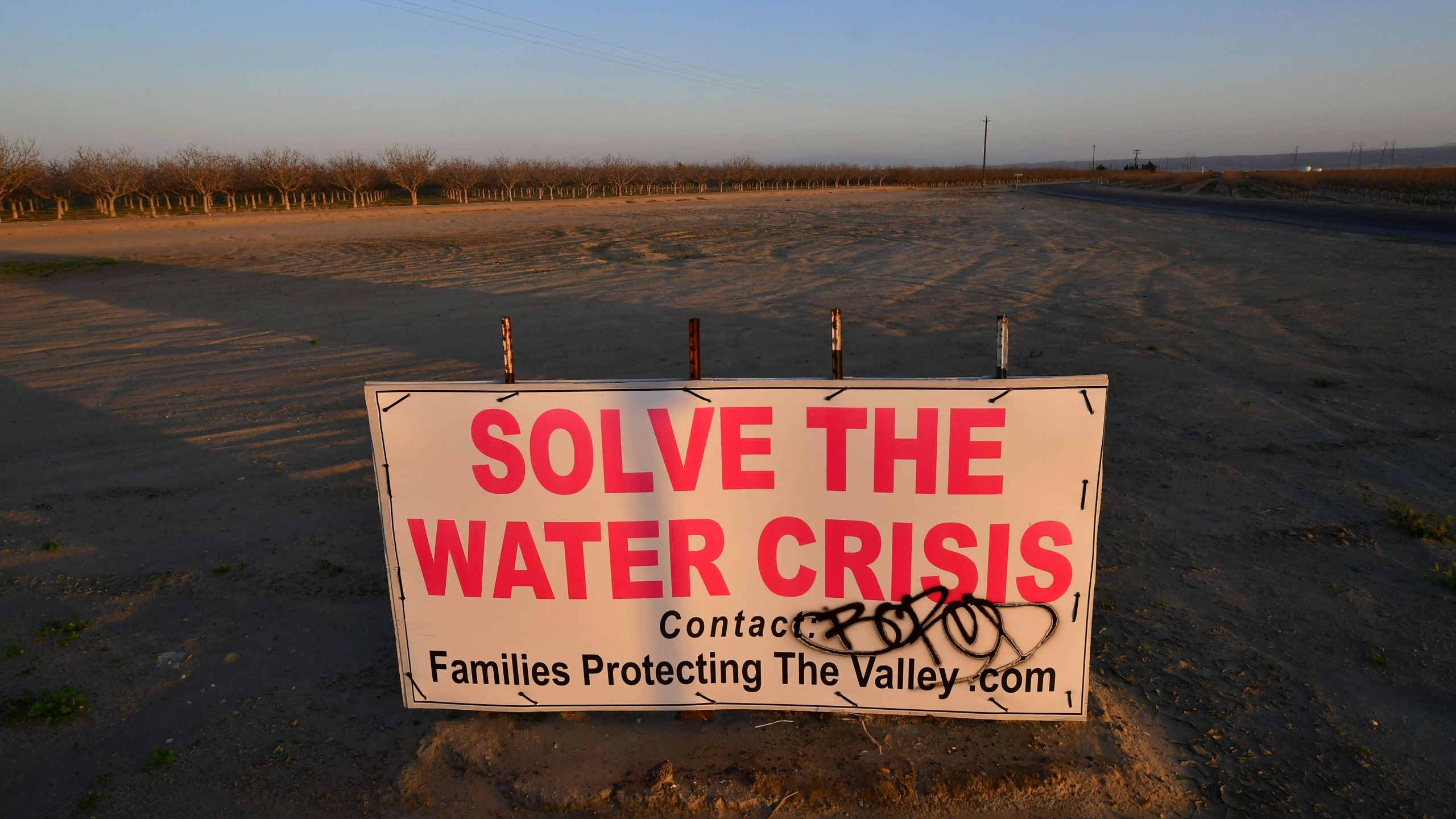 A sign calls for solving California's water crisis on the outskirts of Buttonwillow in California's Kern County on April 2, 2021, one of the top agriculture producing counties in the San Joaquin Valley where dairy, grapes, almonds, strawberries, and pistachios contribute billions to the economy each year. (FREDERIC J. BROWN/AFP via Getty Images)