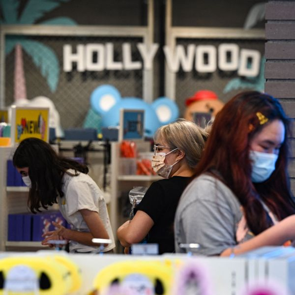 People shop at a store in Hollywood, California, on July 19, 2021, the second day of the return of the indoor mask mandate in Los Angeles County due to a spike in coronavirus cases. (Robyn Beck/AFP via Getty Images)People shop at a store in Hollywood, California, on July 19, 2021, the second day of the return of the indoor mask mandate in Los Angeles County due to a spike in coronavirus cases. (Robyn Beck/AFP via Getty Images)