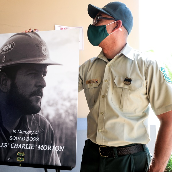 A photograph of fallen Big Bear Interagency Hotshot Charles Morton, a firefighter who was killed battling the El Dorado wildfire, is displayed at a memorial service for Morton on Sept. 25, 2020 in San Bernardino. (Mario Tama / Getty Images)