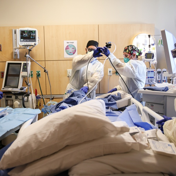 Clinicians perform a tracheostomy on a patient in a COVID-19 ICU at Providence Holy Cross Medical Center in Mission Hills on Feb. 17, 2021 in Los Angeles. (Mario Tama/Getty Images)