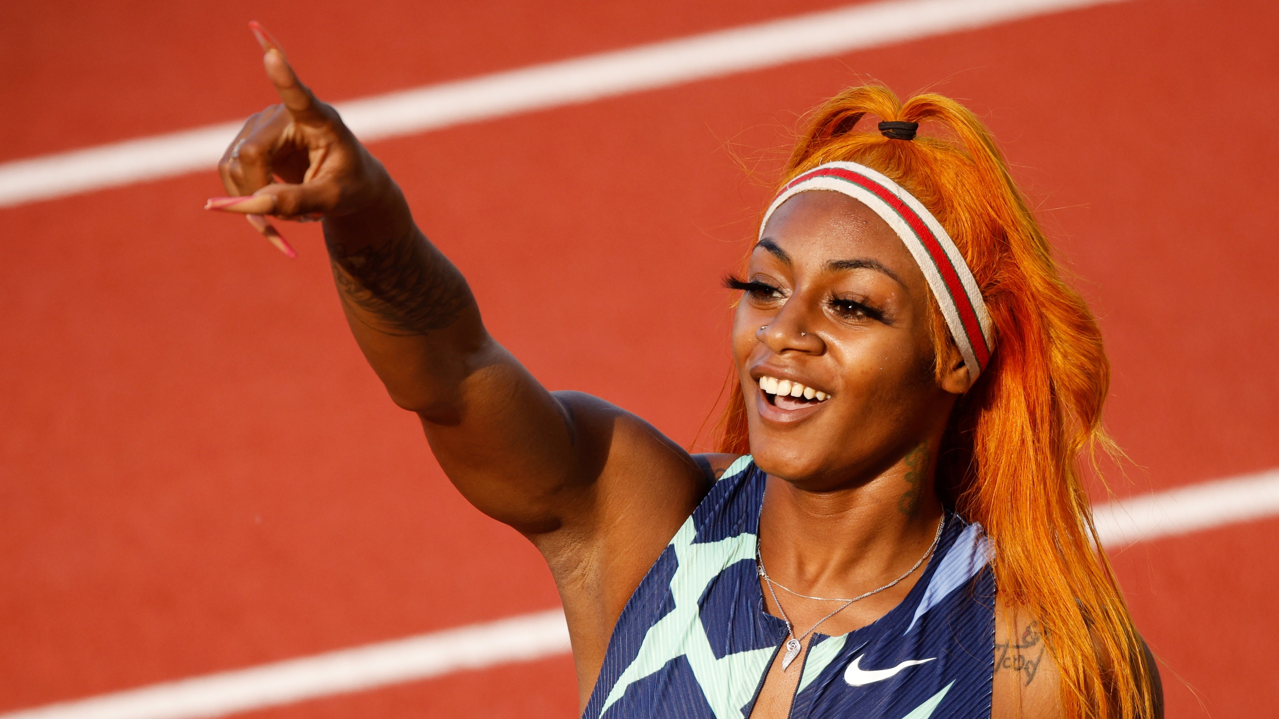 Sha'Carri Richardson reacts after competing in the Women's 100 Meter semi-finals on day two of the 2020 U.S. Olympic Track & Field Team Trials at Hayward Field in Eugene, Oregon, on June 19, 2021. (Cliff Hawkins / Getty Images)