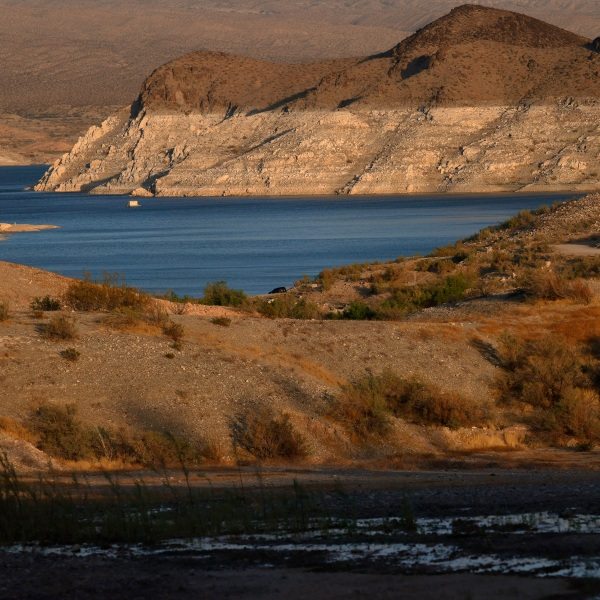 """Mineral-stained rocks are shown at Echo Bay on June 21, 2021 in the Lake Mead National Recreation Area, Nevada. The lake has seen declining water levels as a result of a nearly continuous drought over two decades and increased water demand in the Southwest. The drought has left a white """"bathtub ring"""" of mineral deposits left by higher water levels on the rocks around the lake. ( Ethan Miller/Getty Images)"""