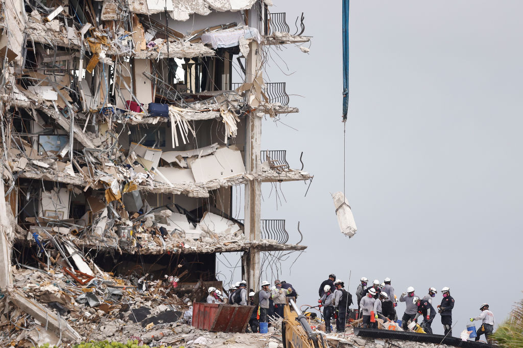 Search and rescue teams look for possible survivors and remains in the partially collapsed 12-story Champlain Towers South condo building on June 30, 2021 in Surfside, Florida. Over 100 people are being reported as missing as the search-and-rescue effort continues. (Photo by Michael Reaves/Getty Images)