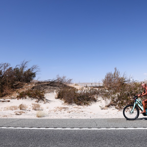 Daryl Luppino rides his bike in the afternoon triple digit heat as part of his exercise regimen on July 09, 2021 near Palm Springs, California. (Mario Tama/Getty Images)