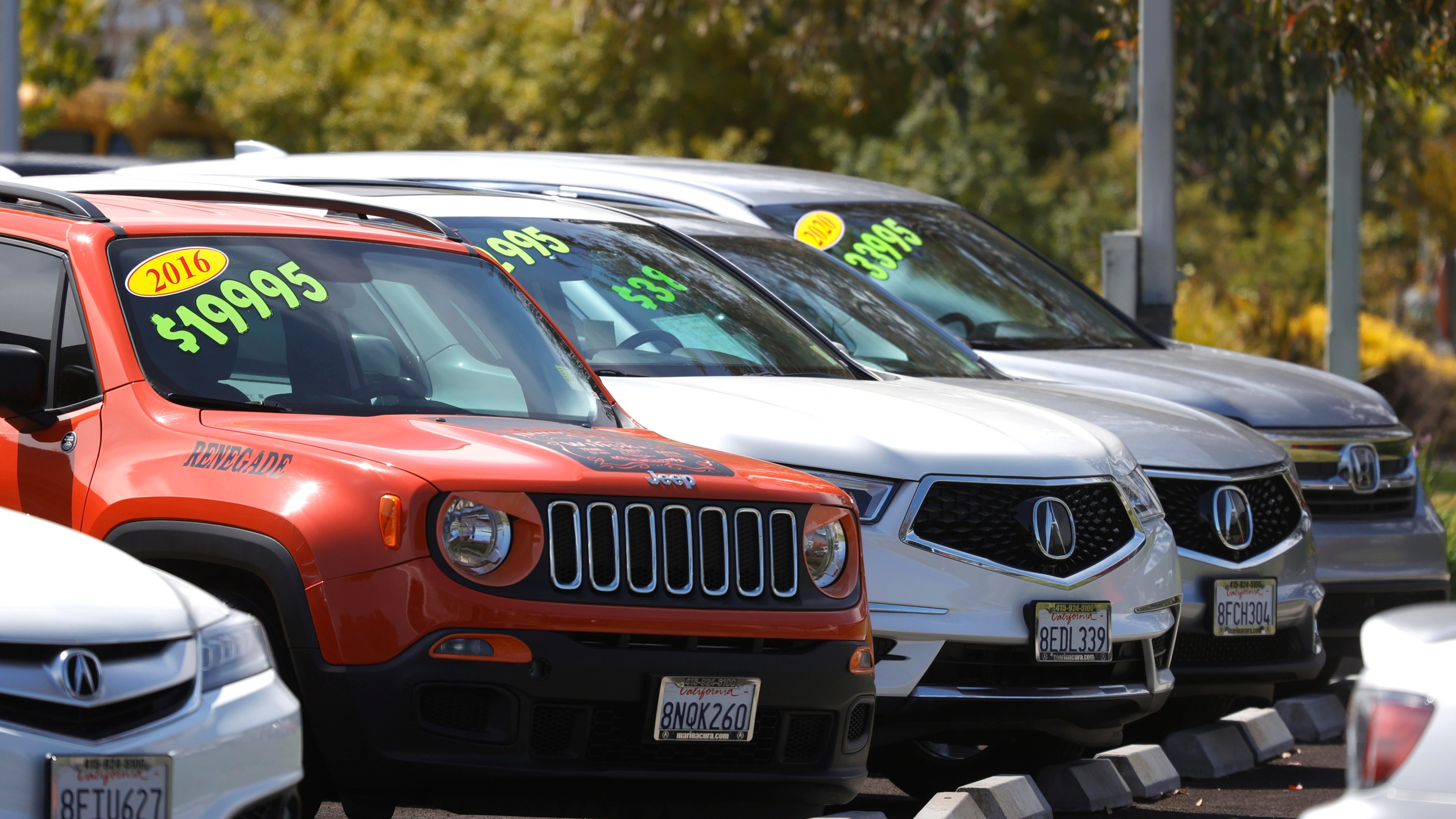Used cars are displayed on the sales lot at Marin Acura on July 13, 2021 in Corte Madera, California. (Justin Sullivan/Getty Images)