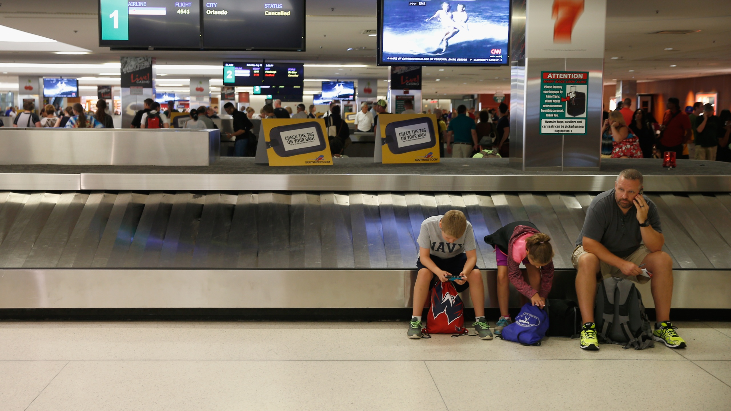 Passengers wait for bags at baggage claim in Baltimore/Washington International Thurgood Marshall Airport in Maryland in this Aug. 15, 2015 file photo. (Rob Carr/Getty Images)