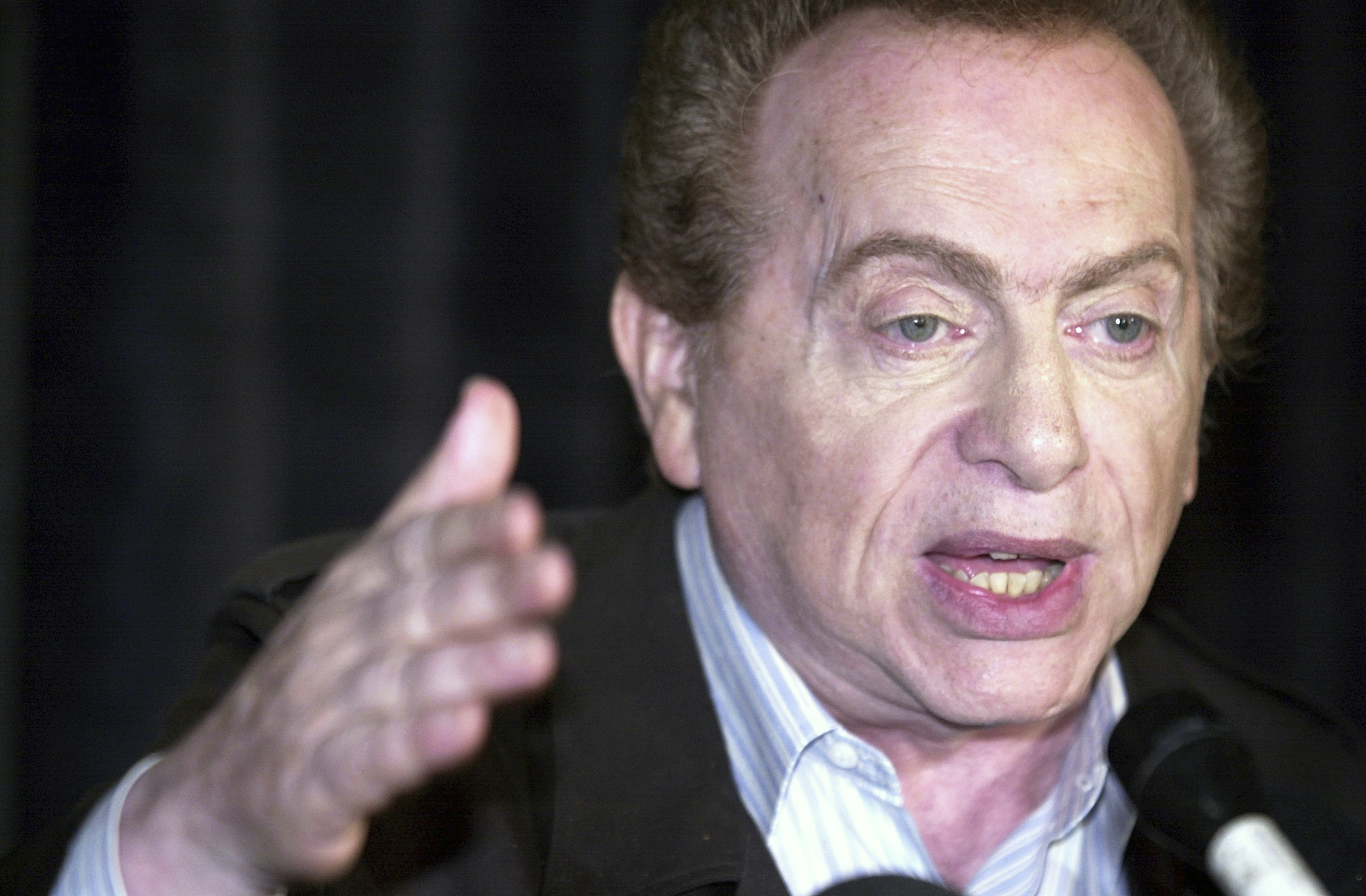 In this Aug 28, 2002, photo, comic Jackie Mason addresses the media at Zanie's comedy club in Chicago about the club's decision to cancel comic Ray Hanania's appearance. (AP Photo/Stephen J. Carrera)